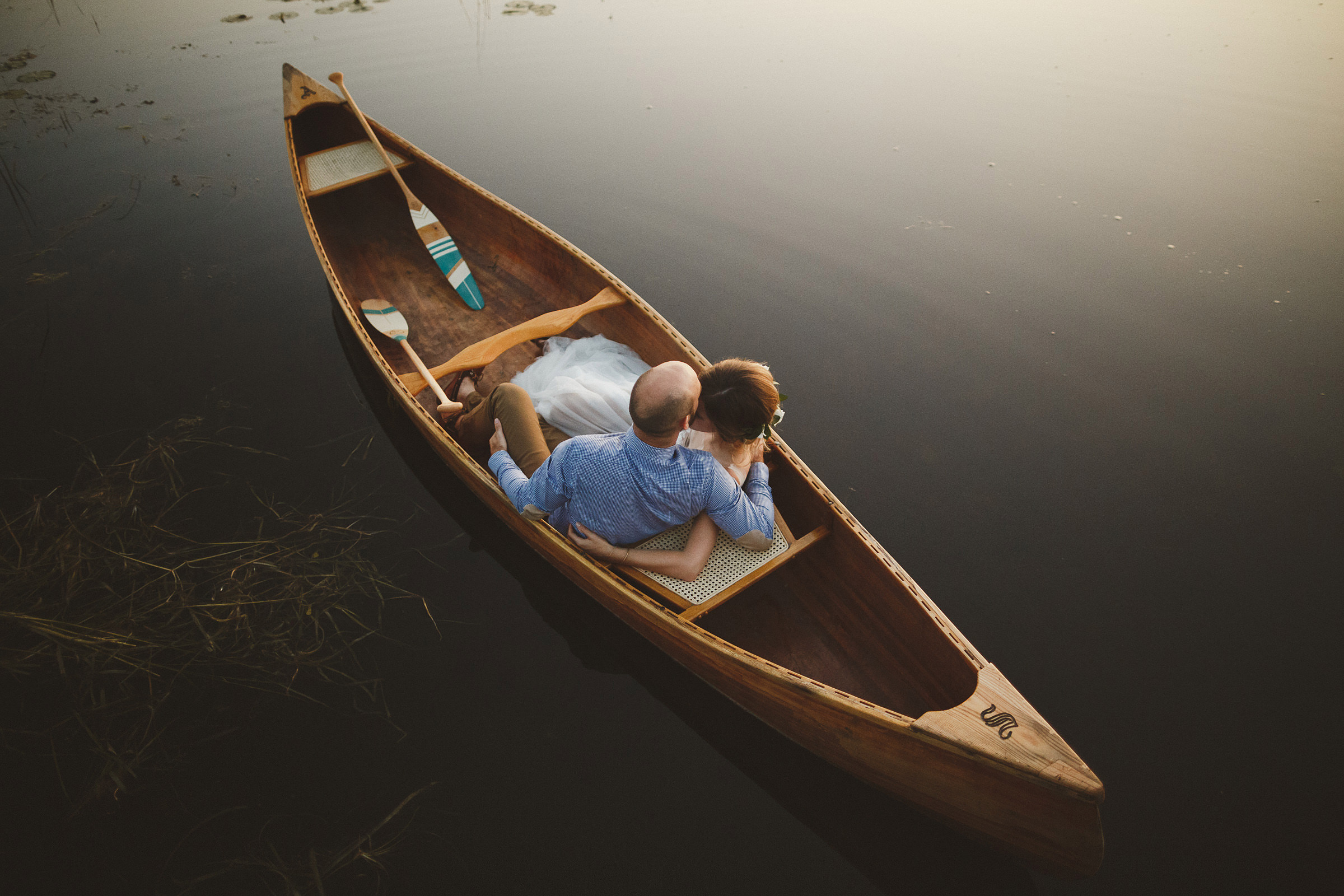 Aerial view of couple in wooden canoe -  photo by Ed Peers Photography