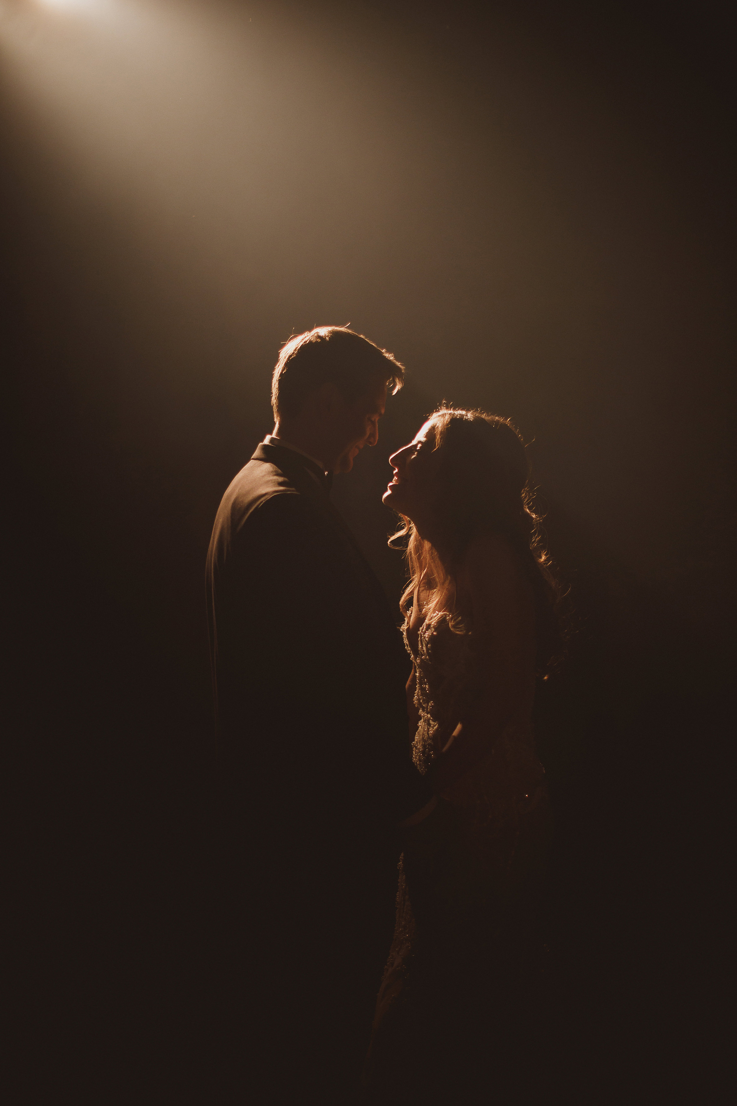 Backlit face to face couple portrait- photo by Ed Peers Photography