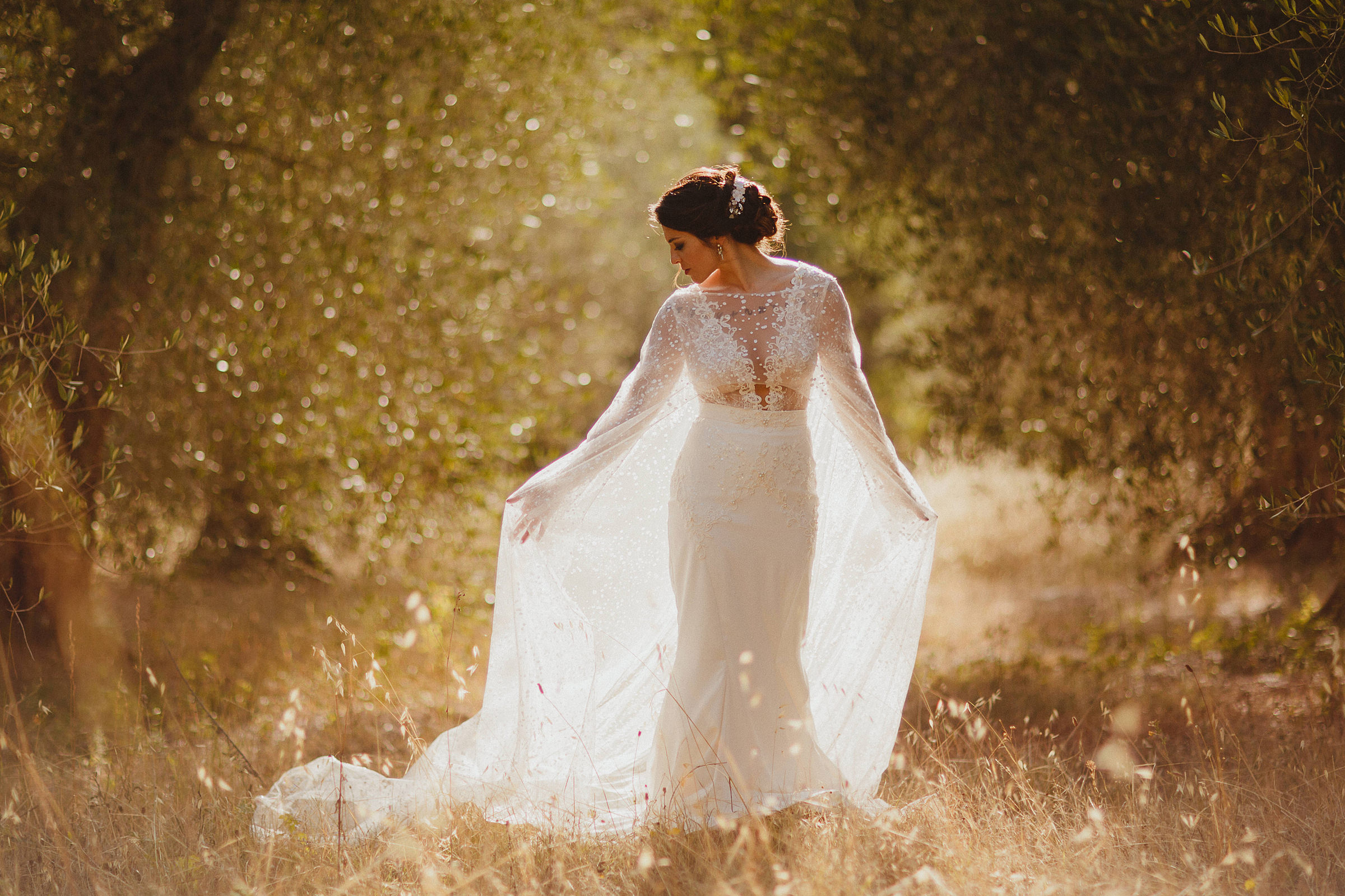 Bride against trees in gown with gauzy shawl - photo by Ed Peers Photography