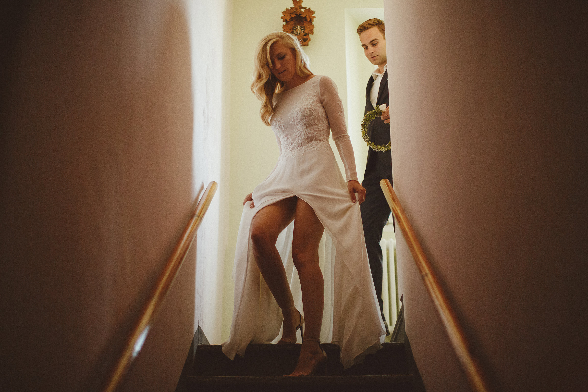 Bride descending stairs in slitted gown - photo by Ed Peers Photography