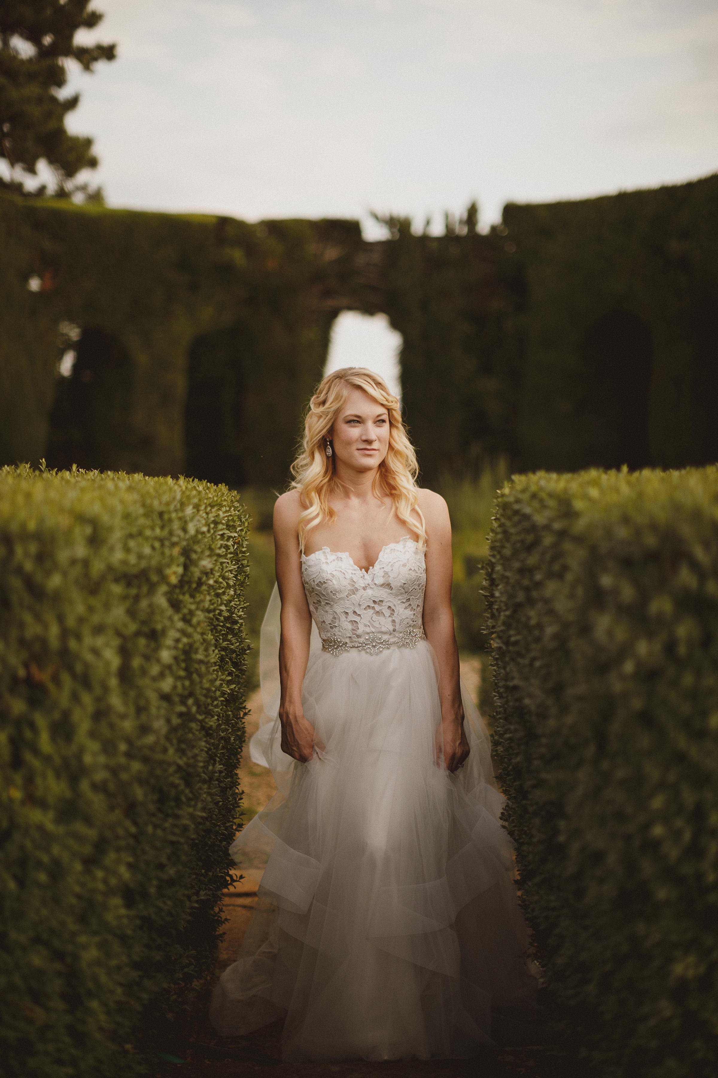 Bride pose in garden - photo by Ed Peers Photography