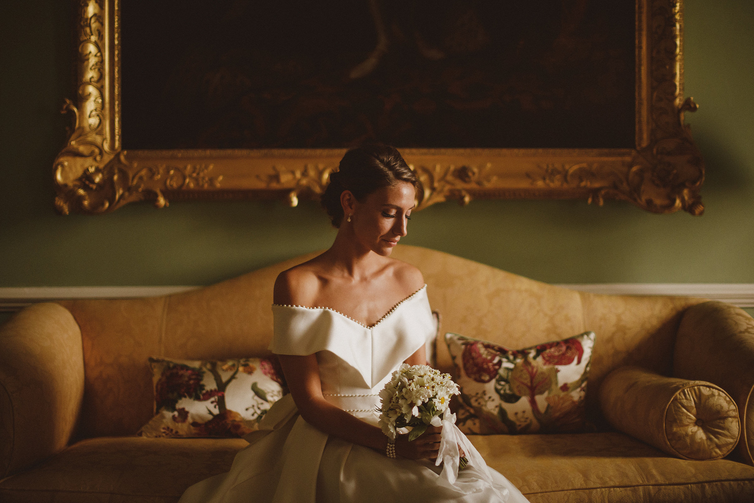 Contemplative bride on couch - photo by Ed Peers Photography
