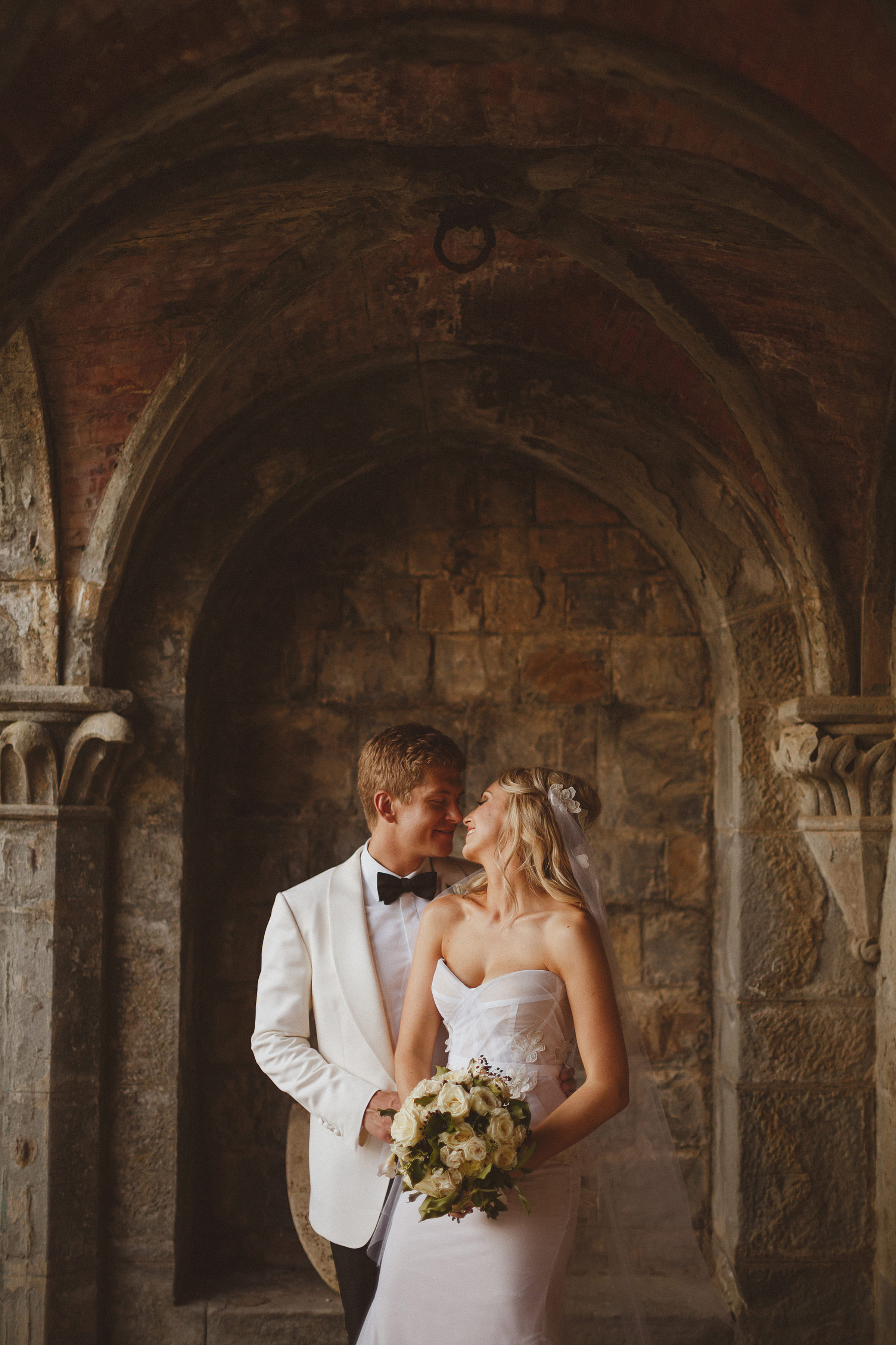Couple against historic stone architecture - photo by Ed Peers Photography