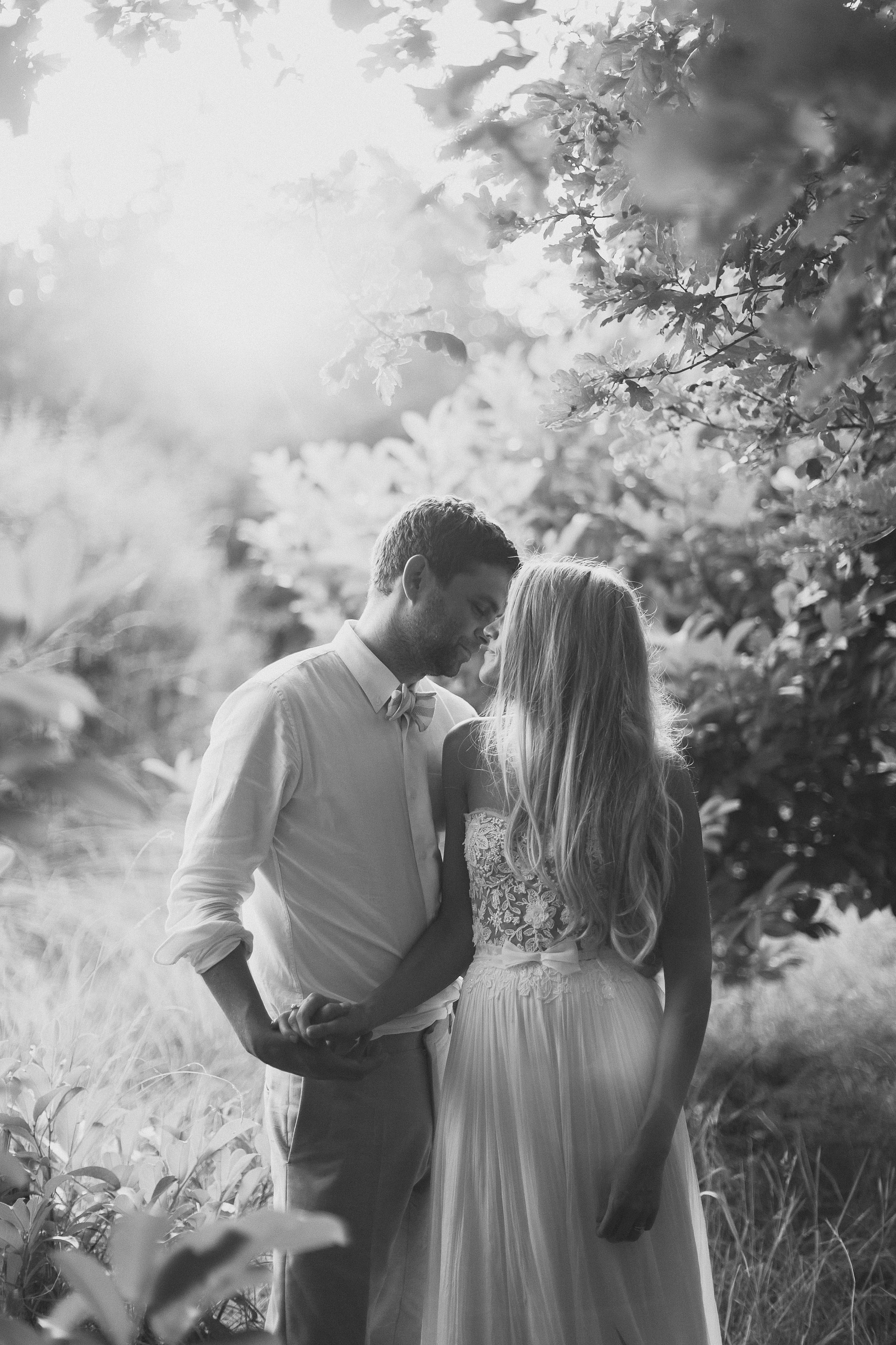 Couple against trees - photo by Ed Peers Photography