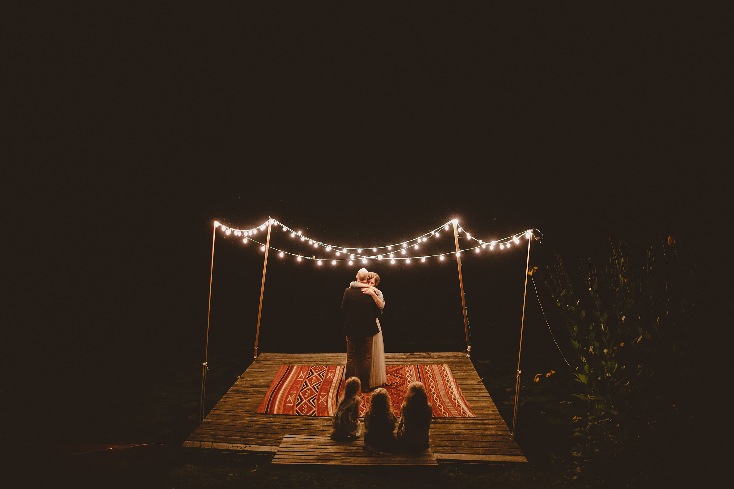Couple dance on outdoor stage under string lights - photo by Ed Peers Photography