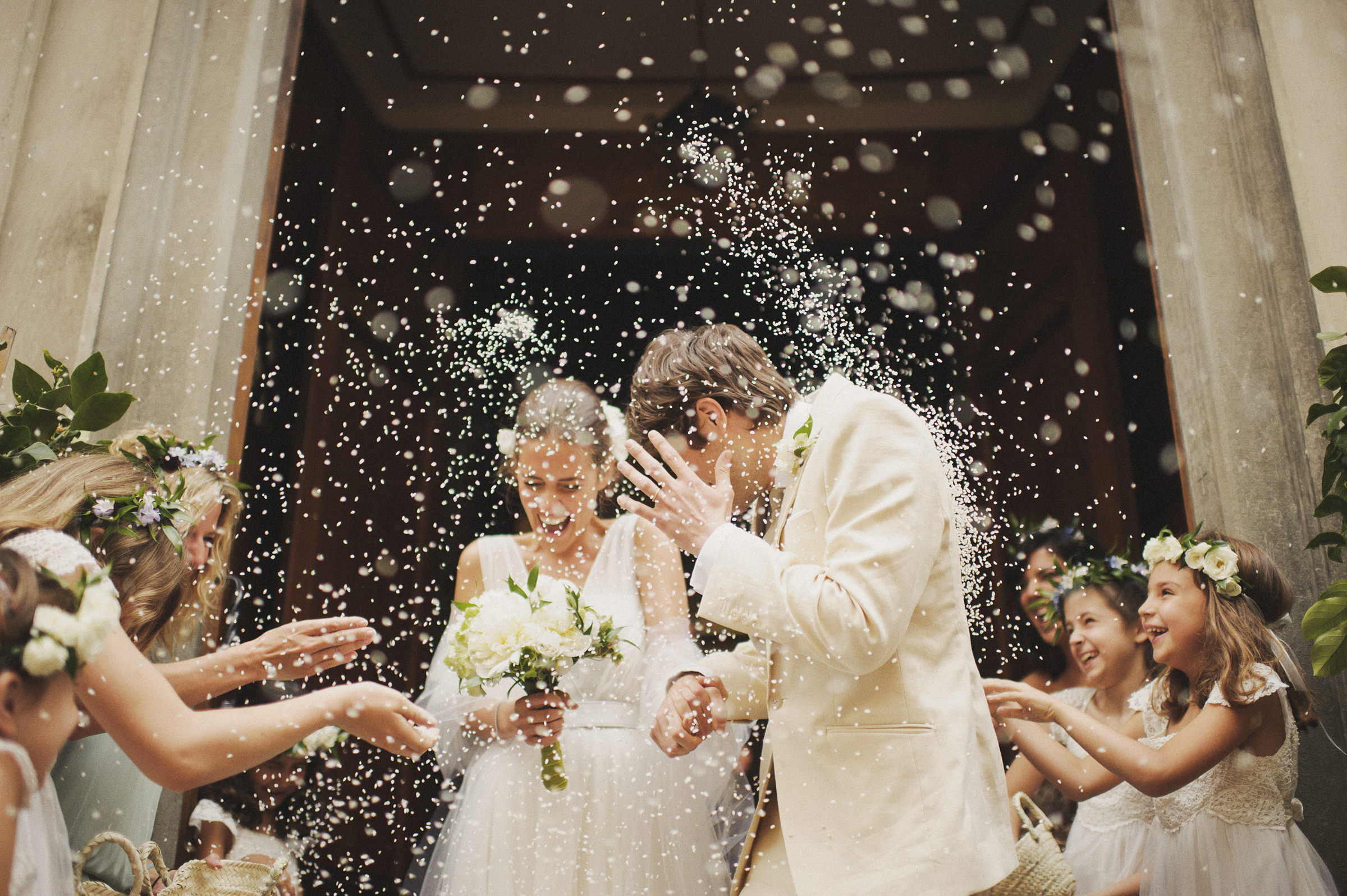 Couple exits church to rice shower - photo by Ed Peers Photography