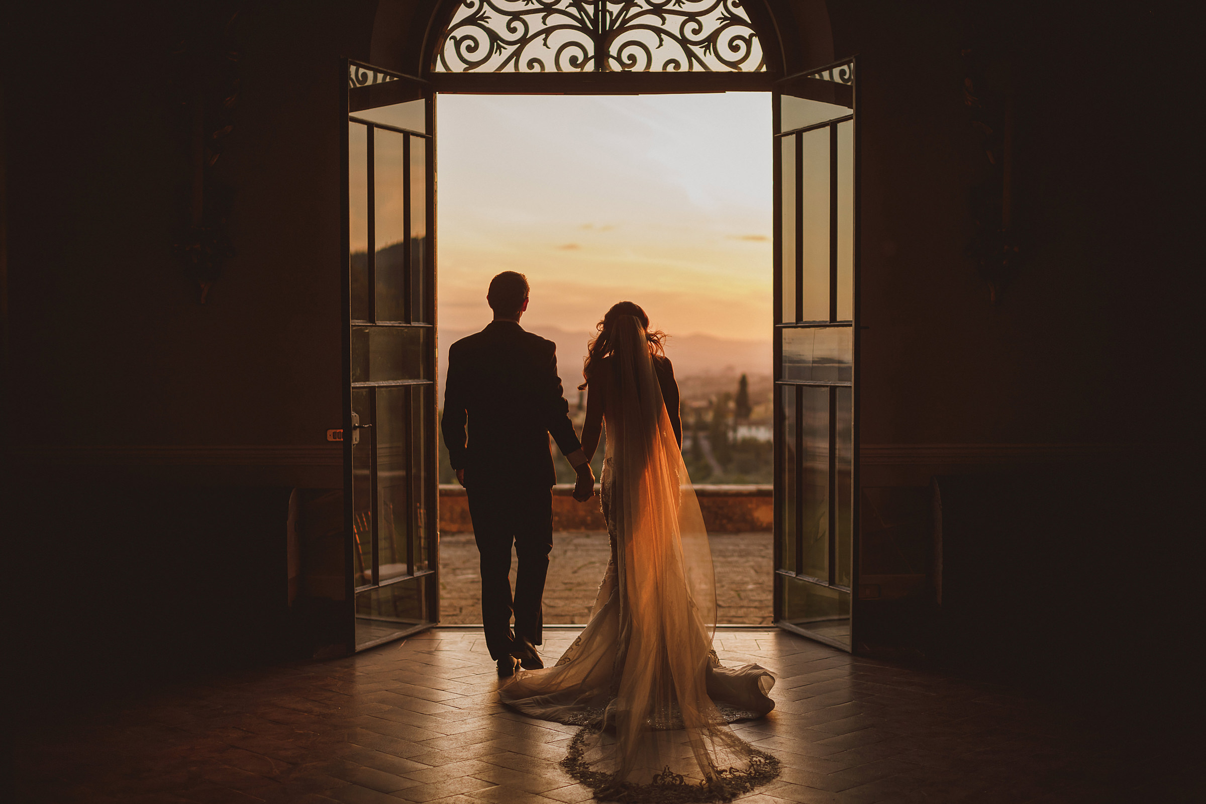 Couple in ornate doorway at sunset - photo by Ed Peers Photography