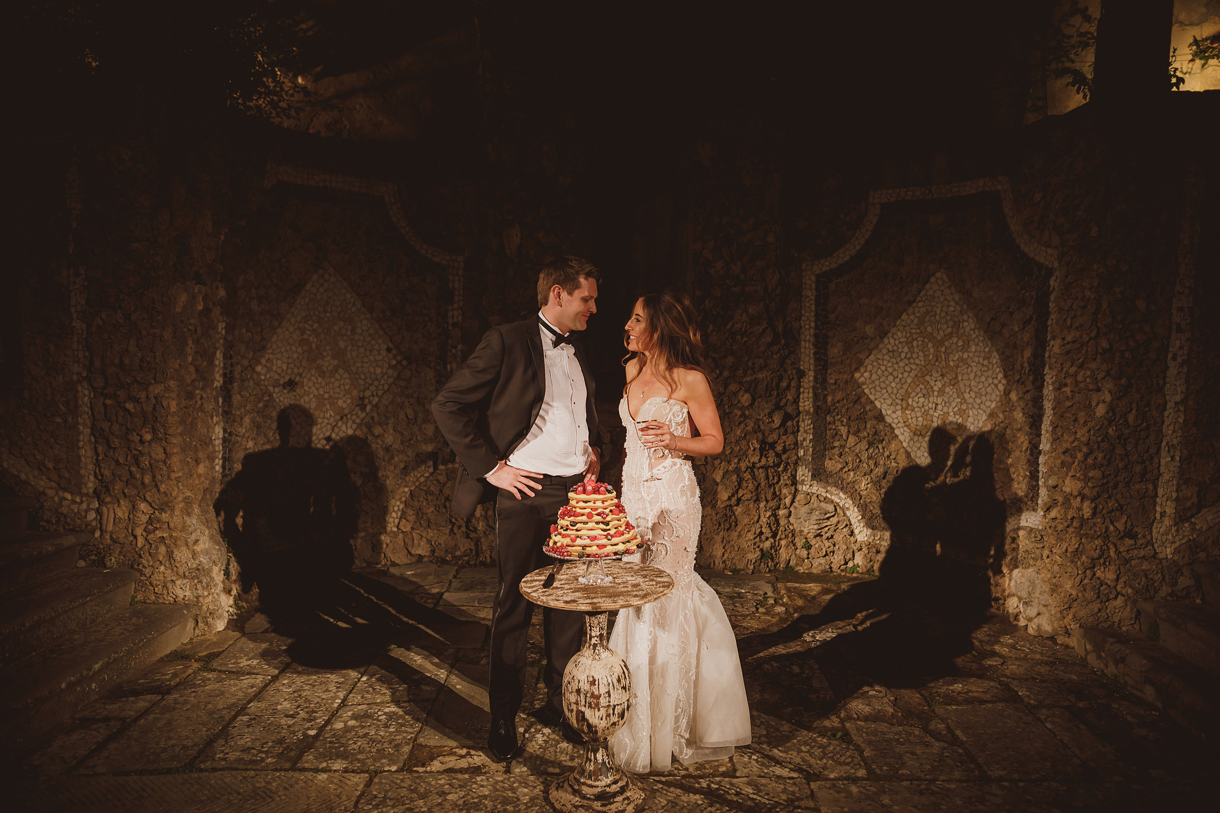 Couple in stone grotto with cake - photo by Ed Peers Photography