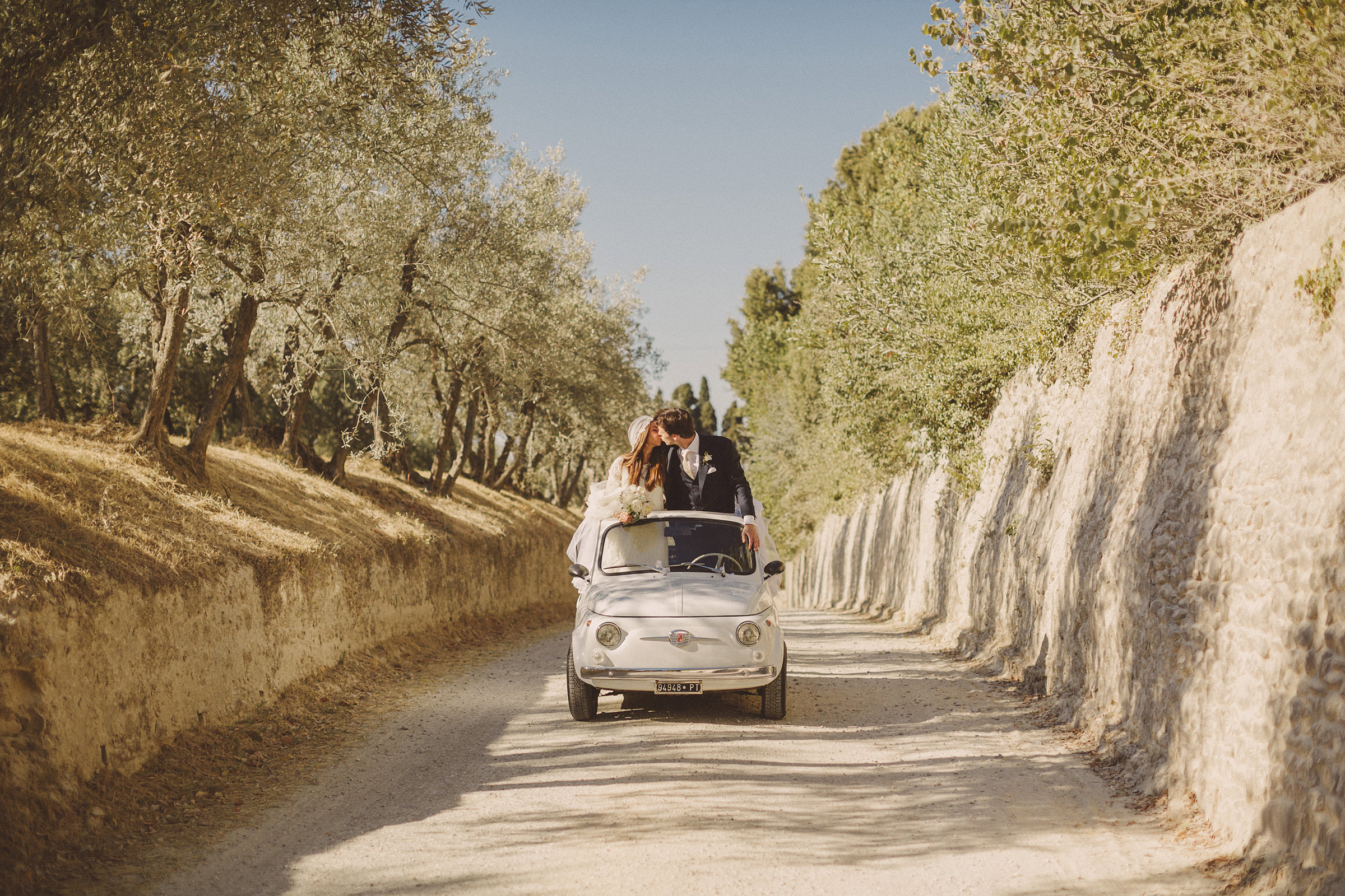Couple kiss in small white car - photo by Ed Peers Photography