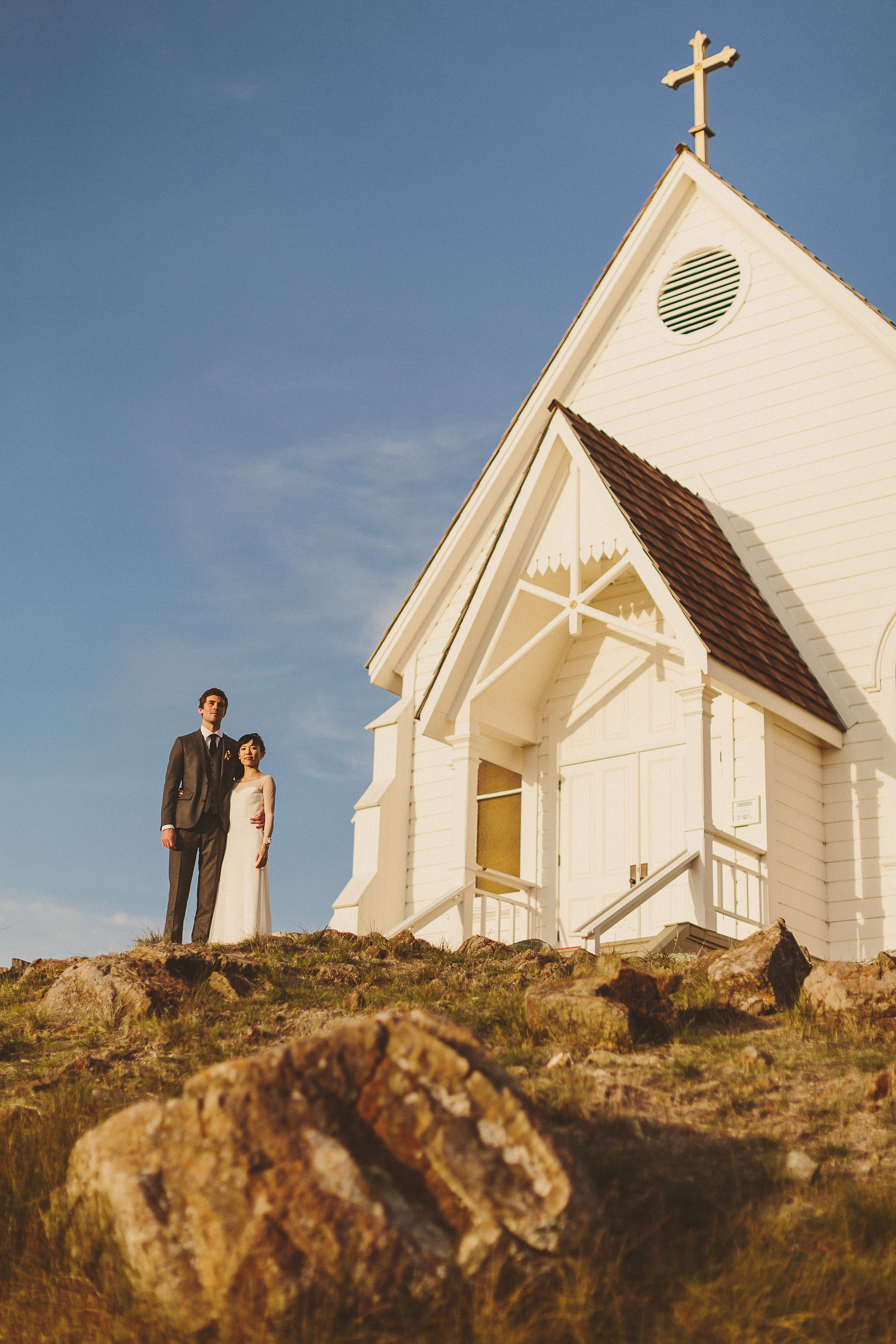 Couple outside rustic white church - photo by Ed Peers Photography