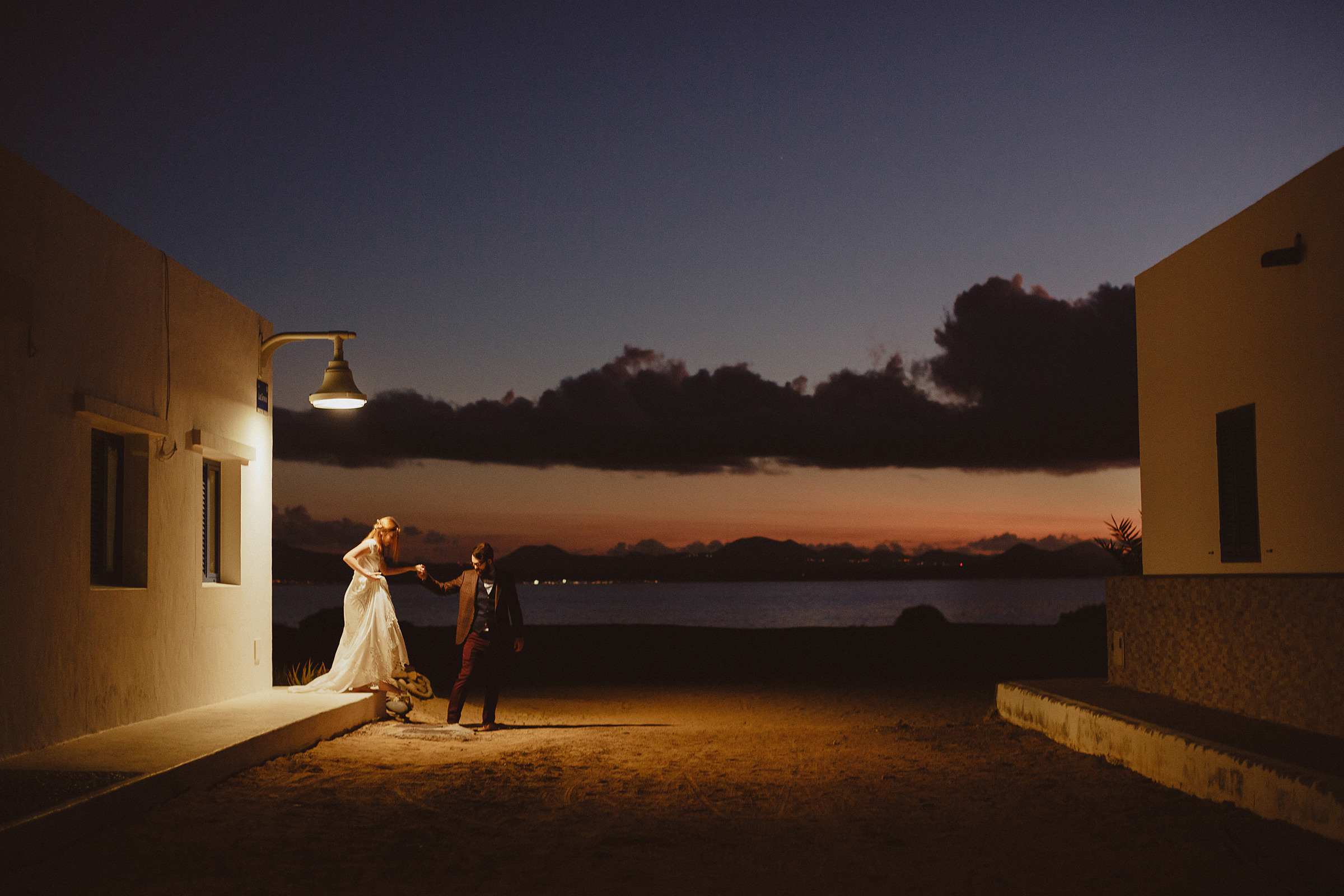 Couple portrait against adobe and sunset sky - photo by Ed Peers Photography