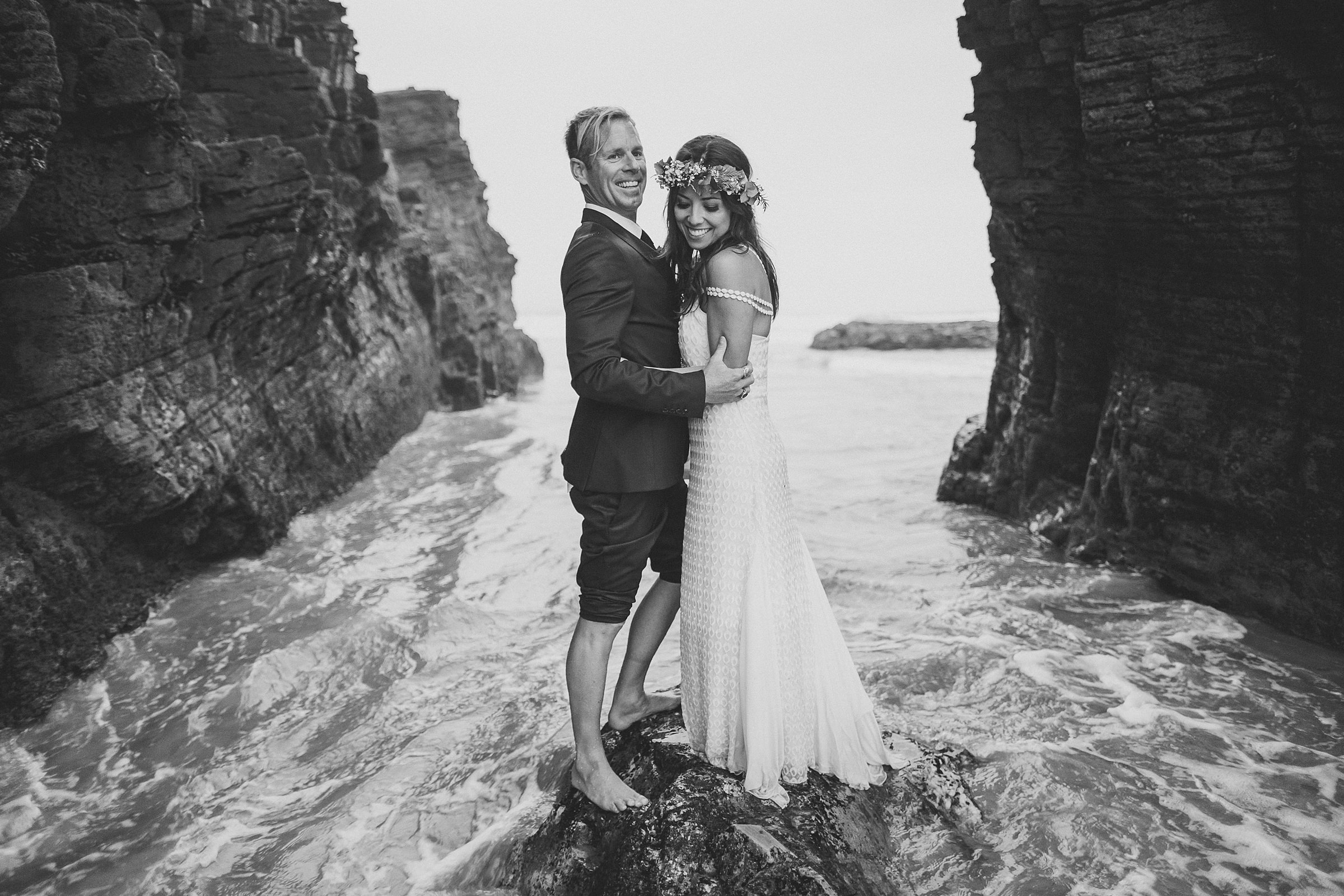 Couple portrait getting their feet wet - photo by Ed Peers Photography