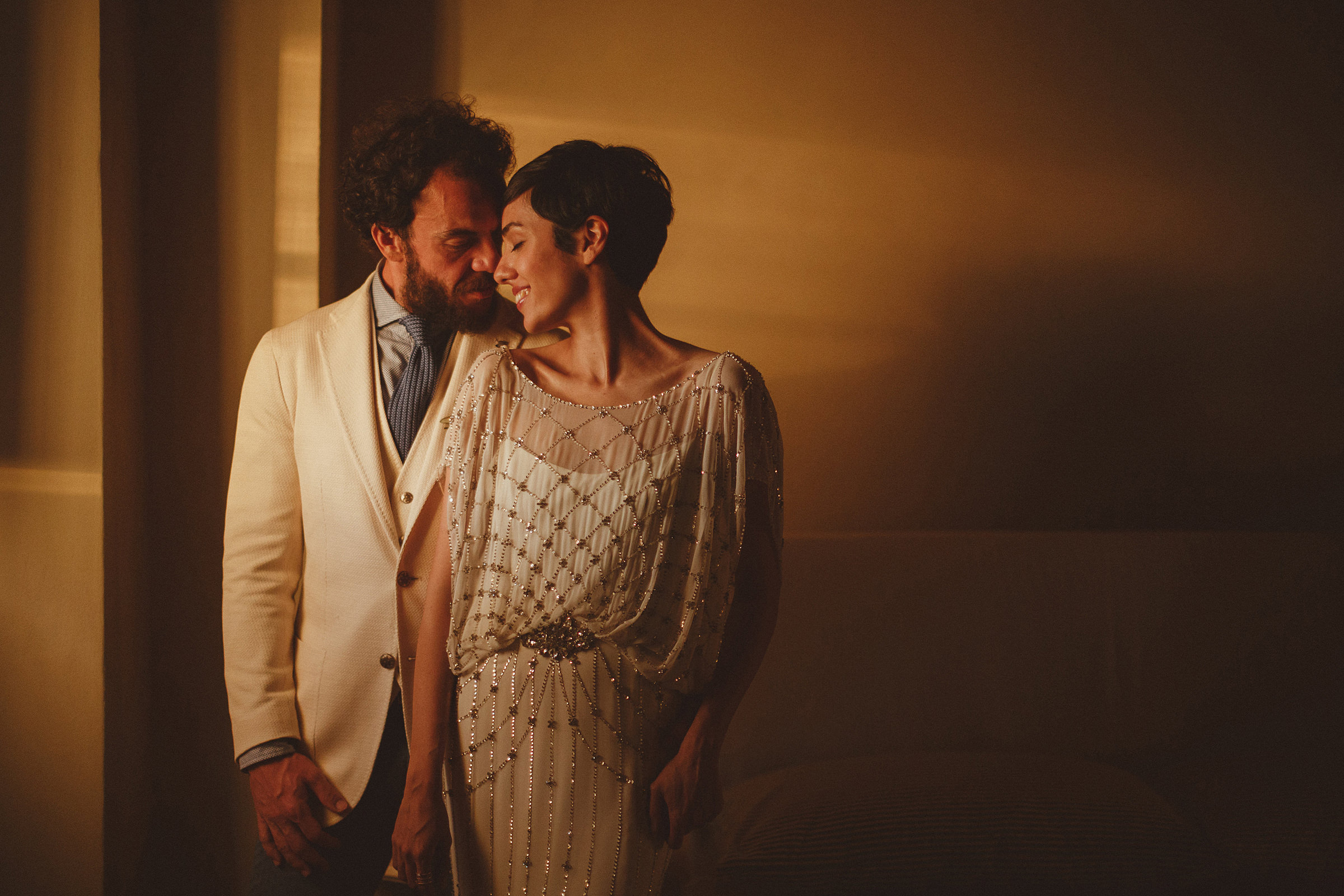 Couple portrait in low window light - photo by Ed Peers Photography