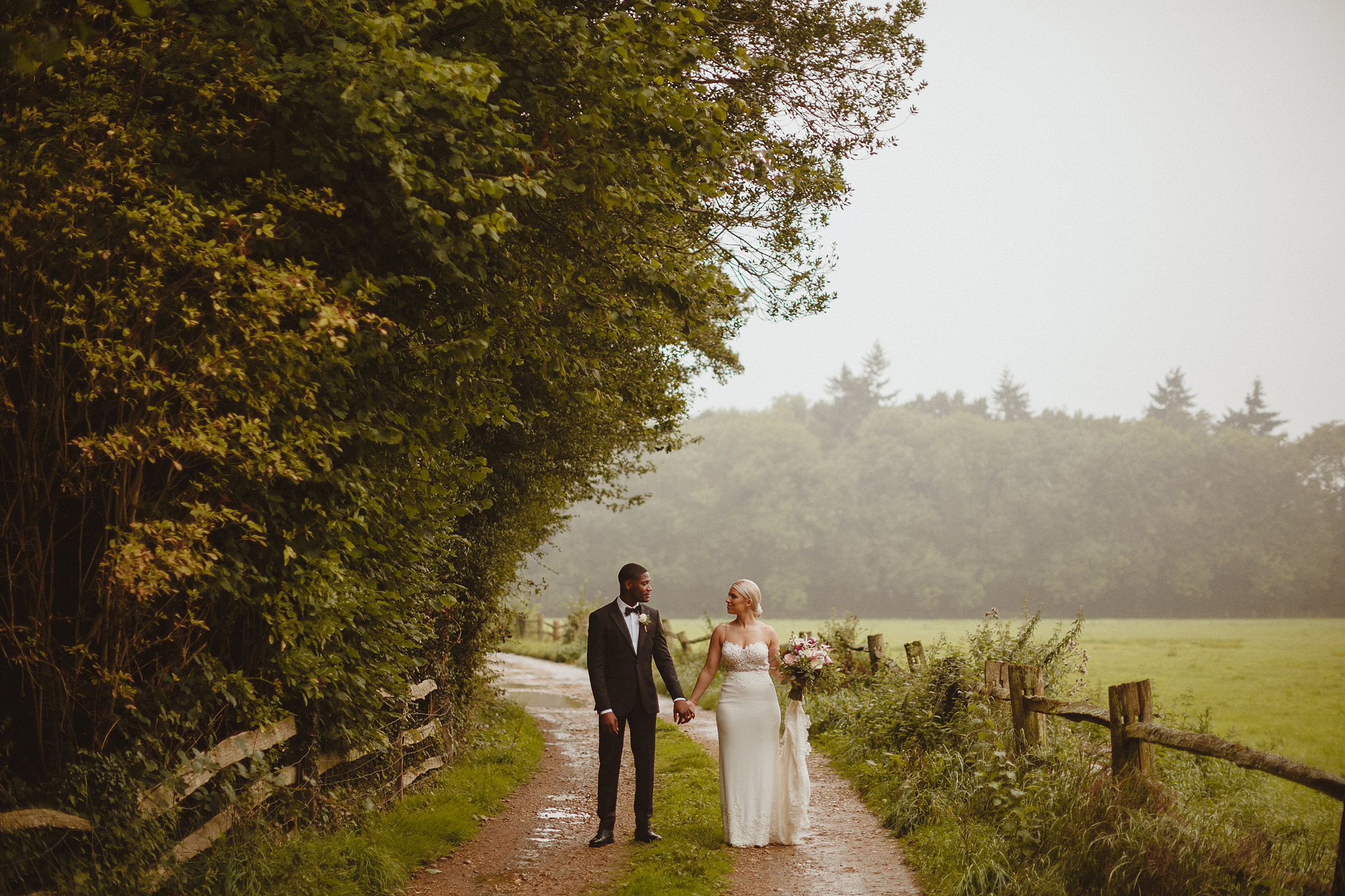 Couple portrait on country road - photo by Ed Peers Photography
