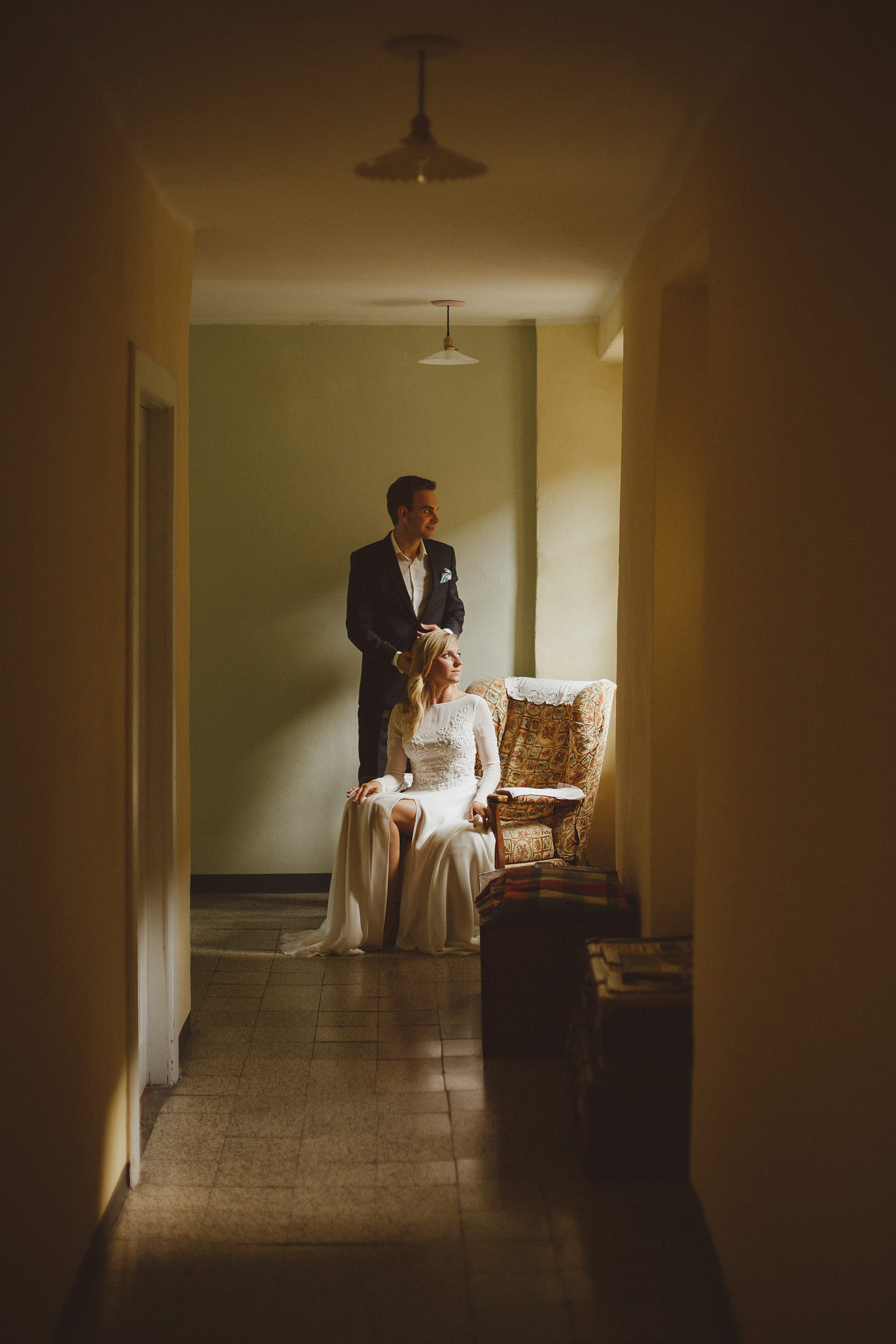 Couple portrait seated bride with window lighting - photo by Ed Peers Photography