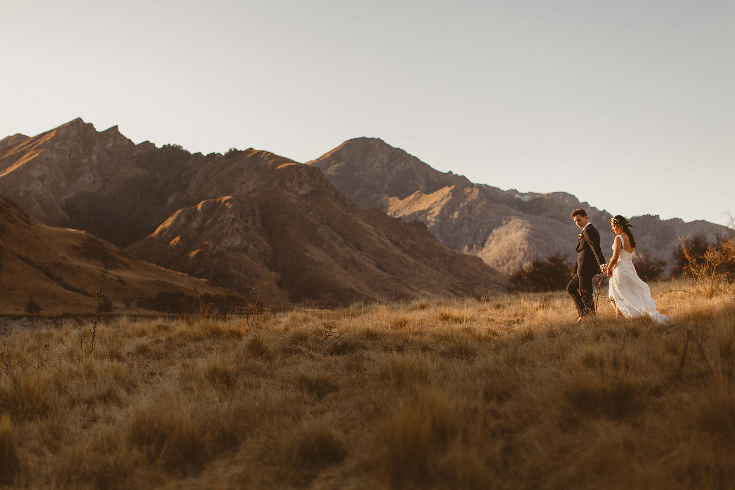 Couple walking against mountain backdrop - photo by Ed Peers Photography