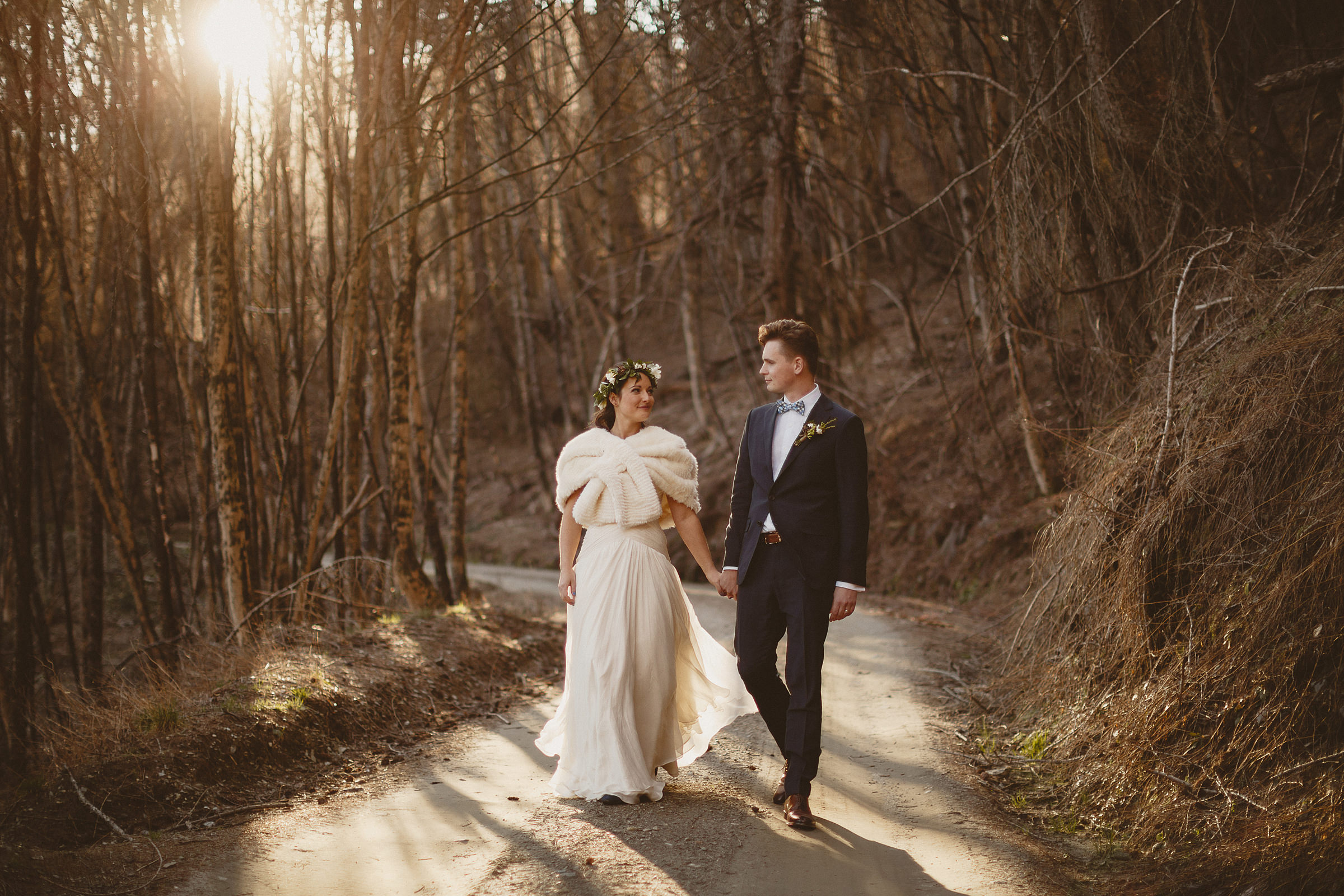 Couple walking down wooded road - photo by Ed Peers Photography