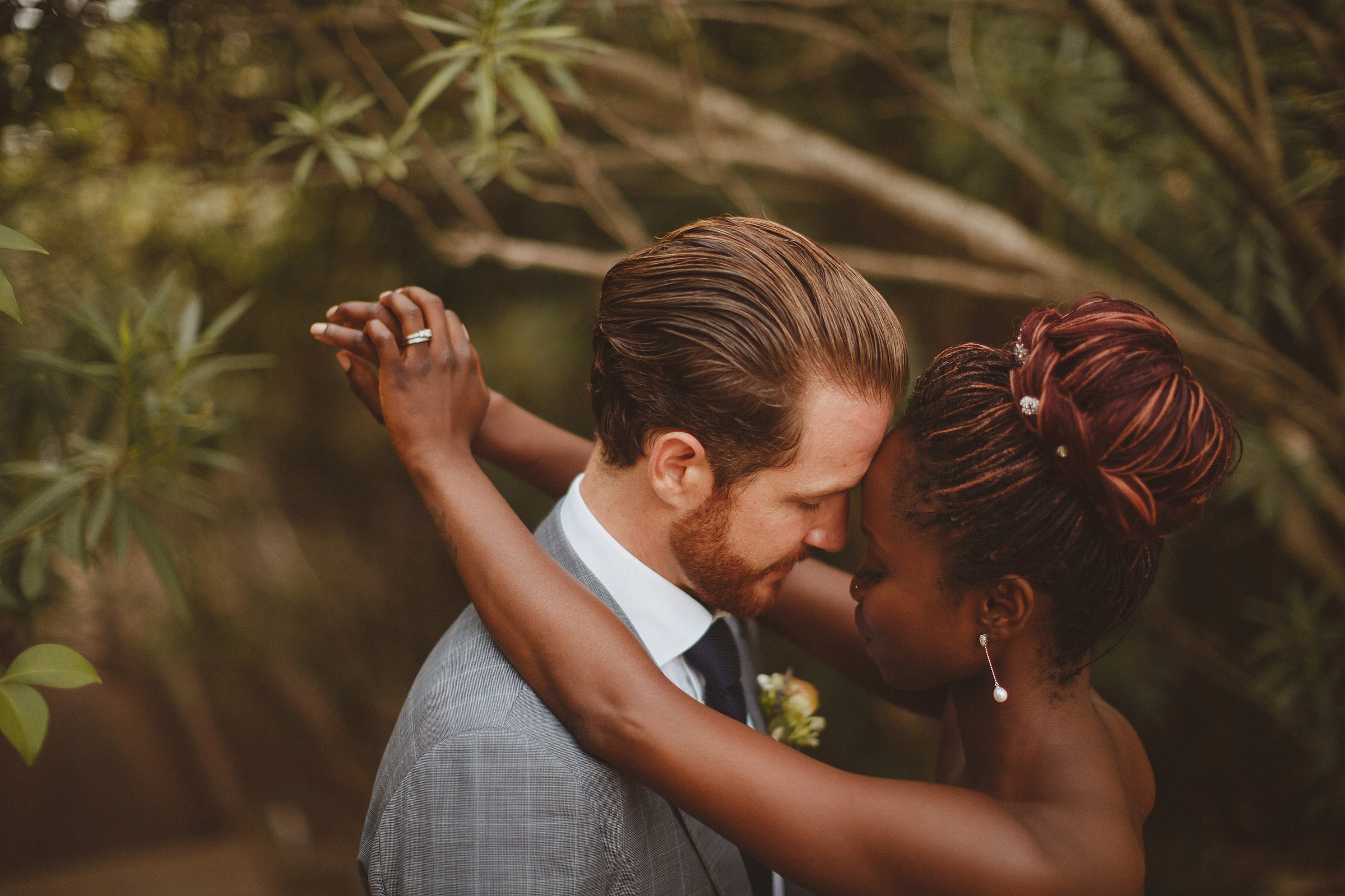 Face to face couple amid foliage - photo by Ed Peers Photography