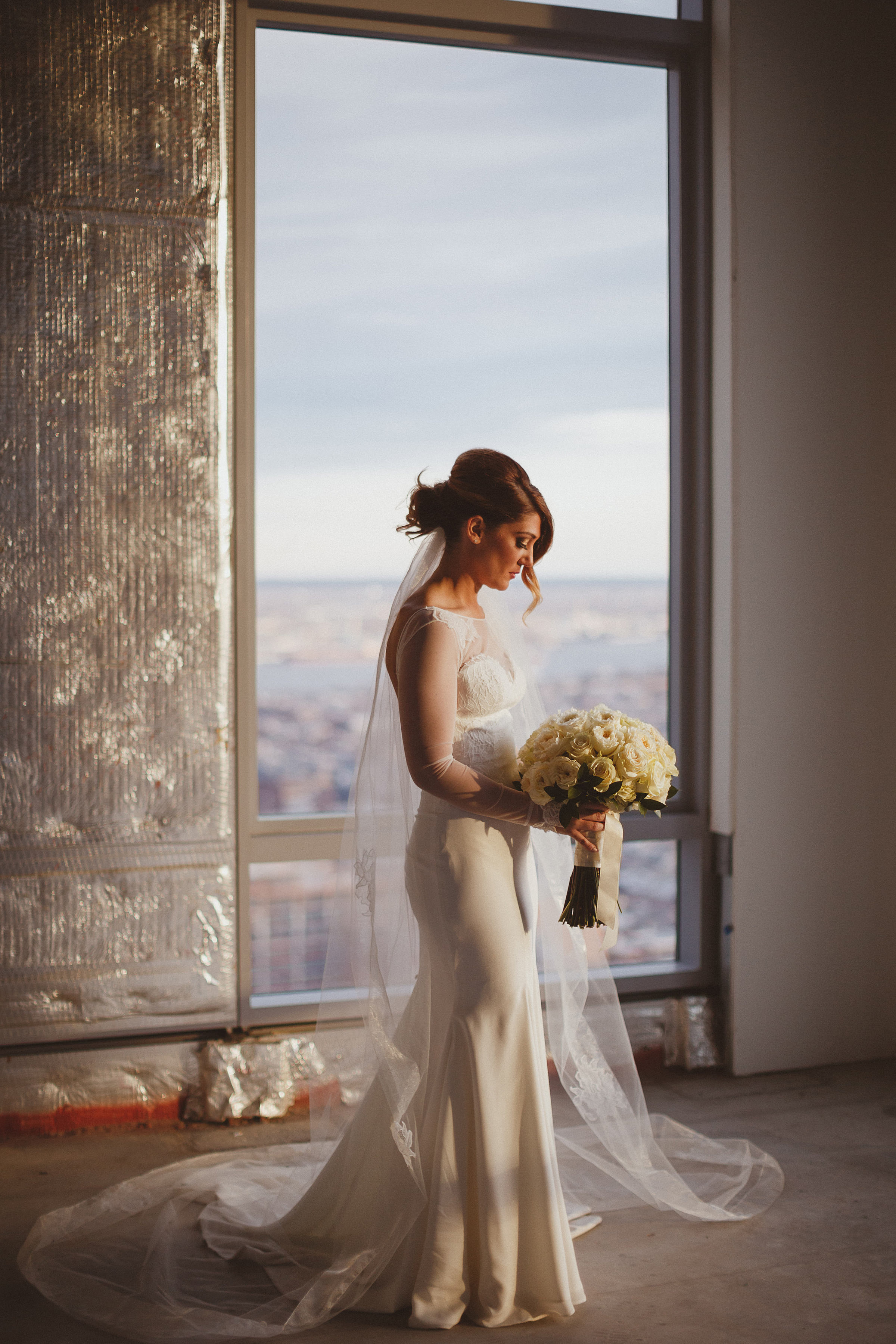 Full length bridal portrait against window - photo by Ed Peers Photography