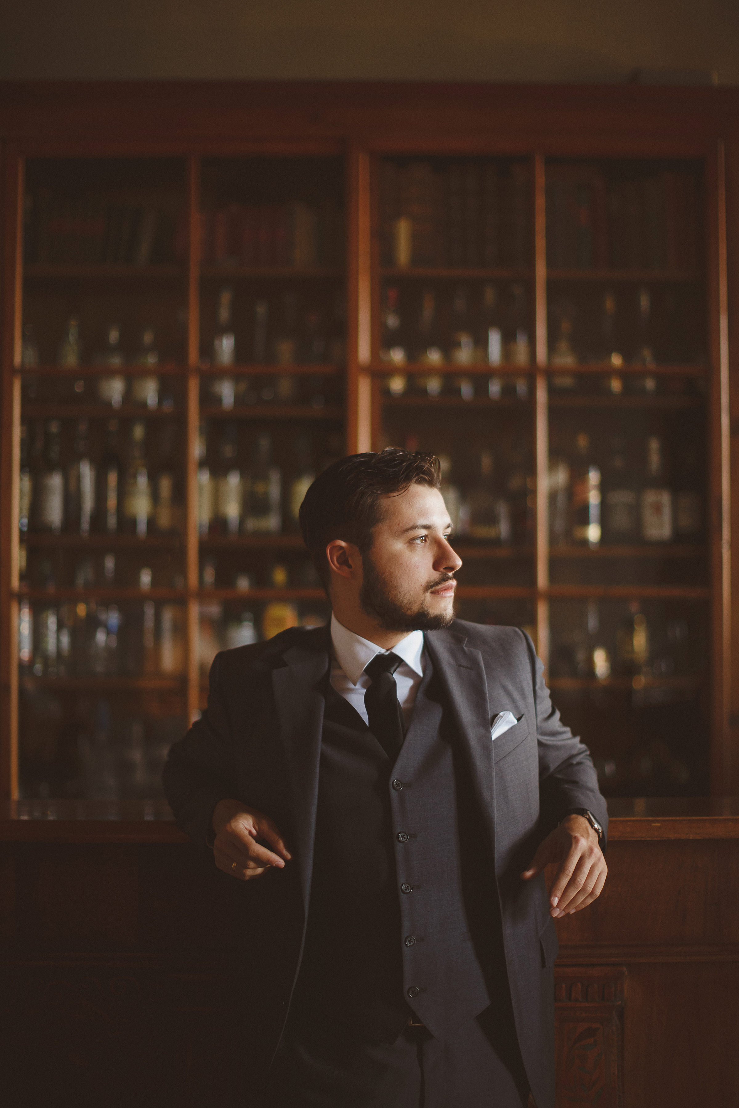 Groom portrait against back bar - photo by Ed Peers Photography