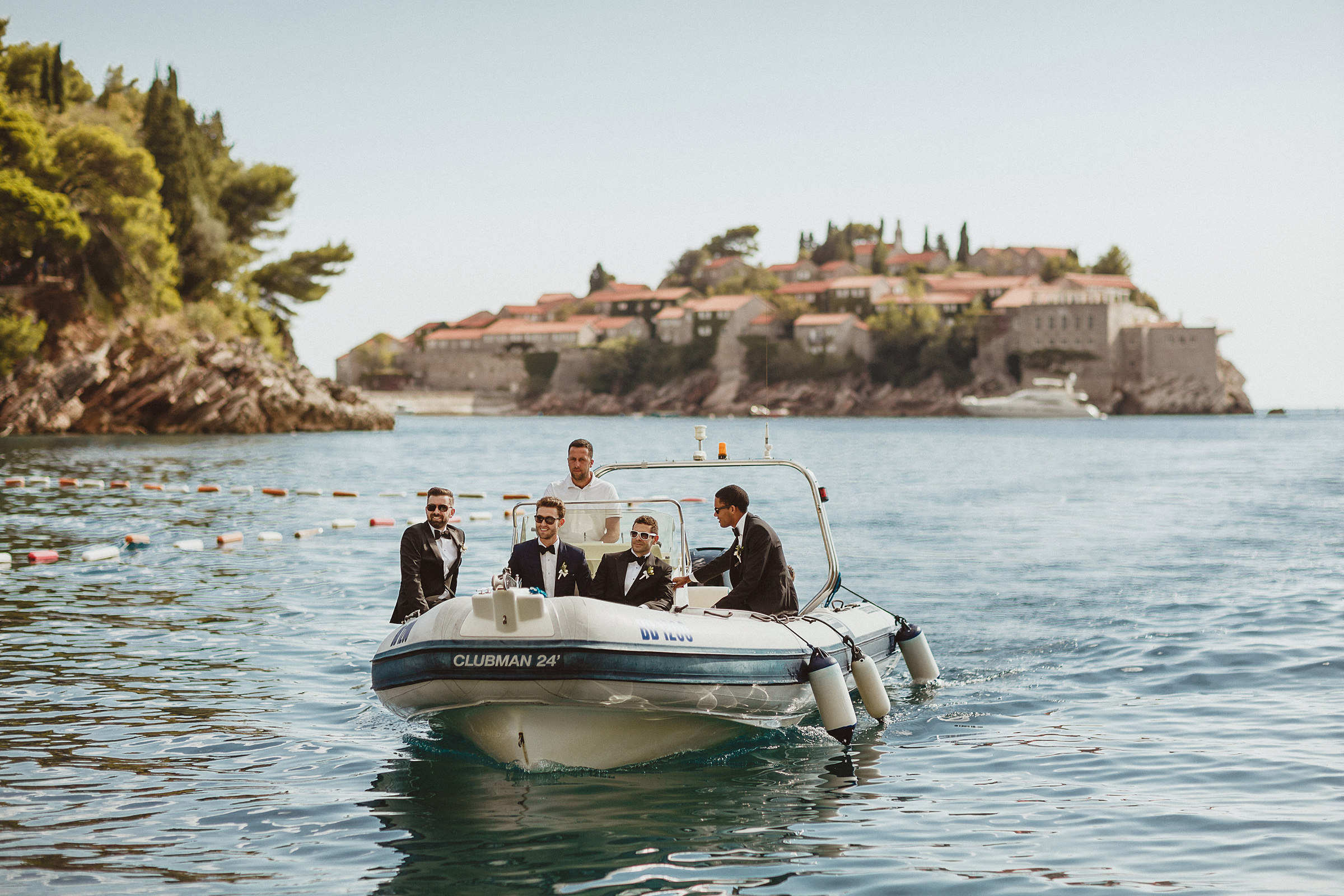 Groomsmen in small boat - photo by Ed Peers Photography