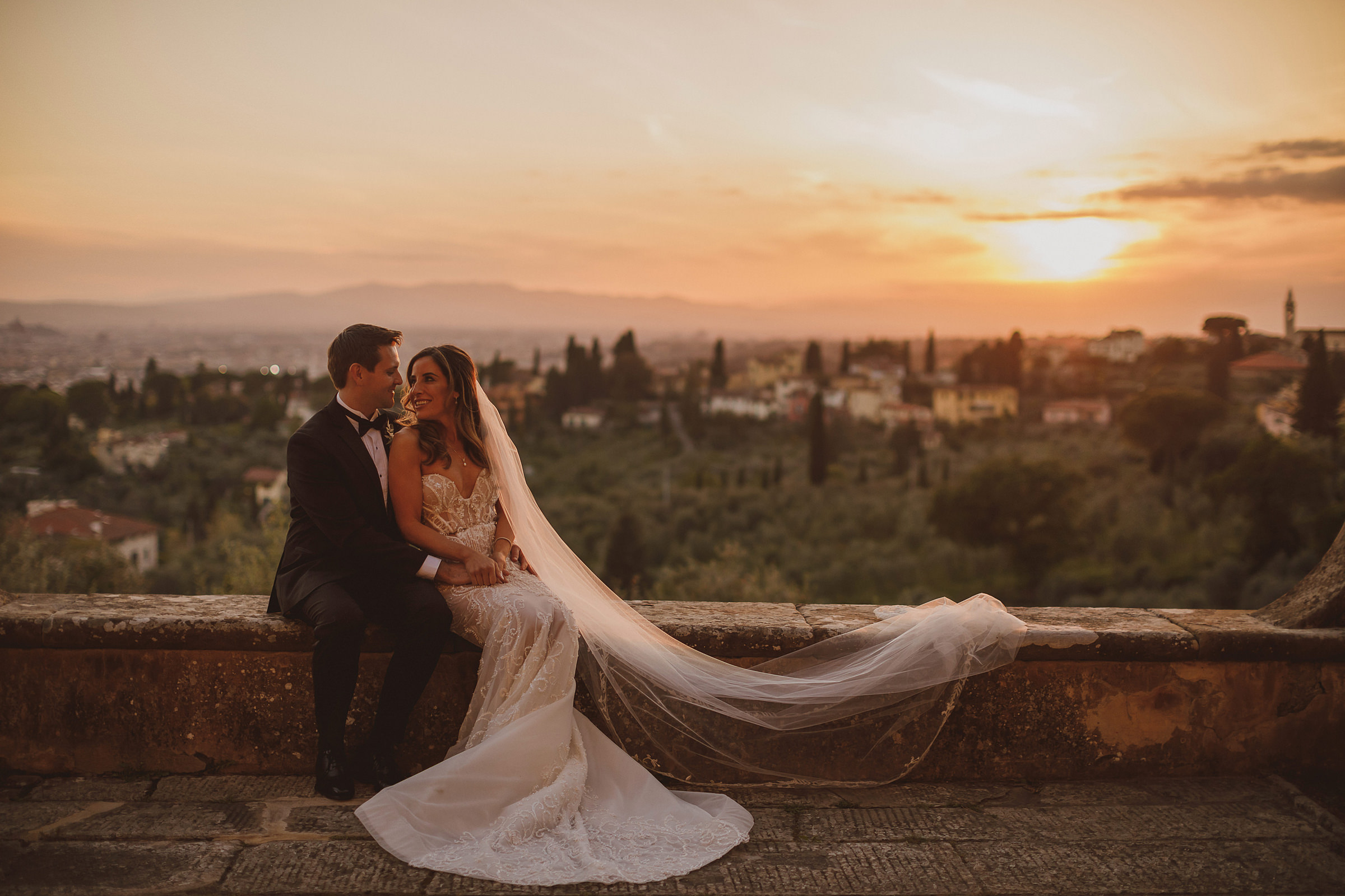 Outdoor seated couple portrait against country skyline - photo by Ed Peers Photography