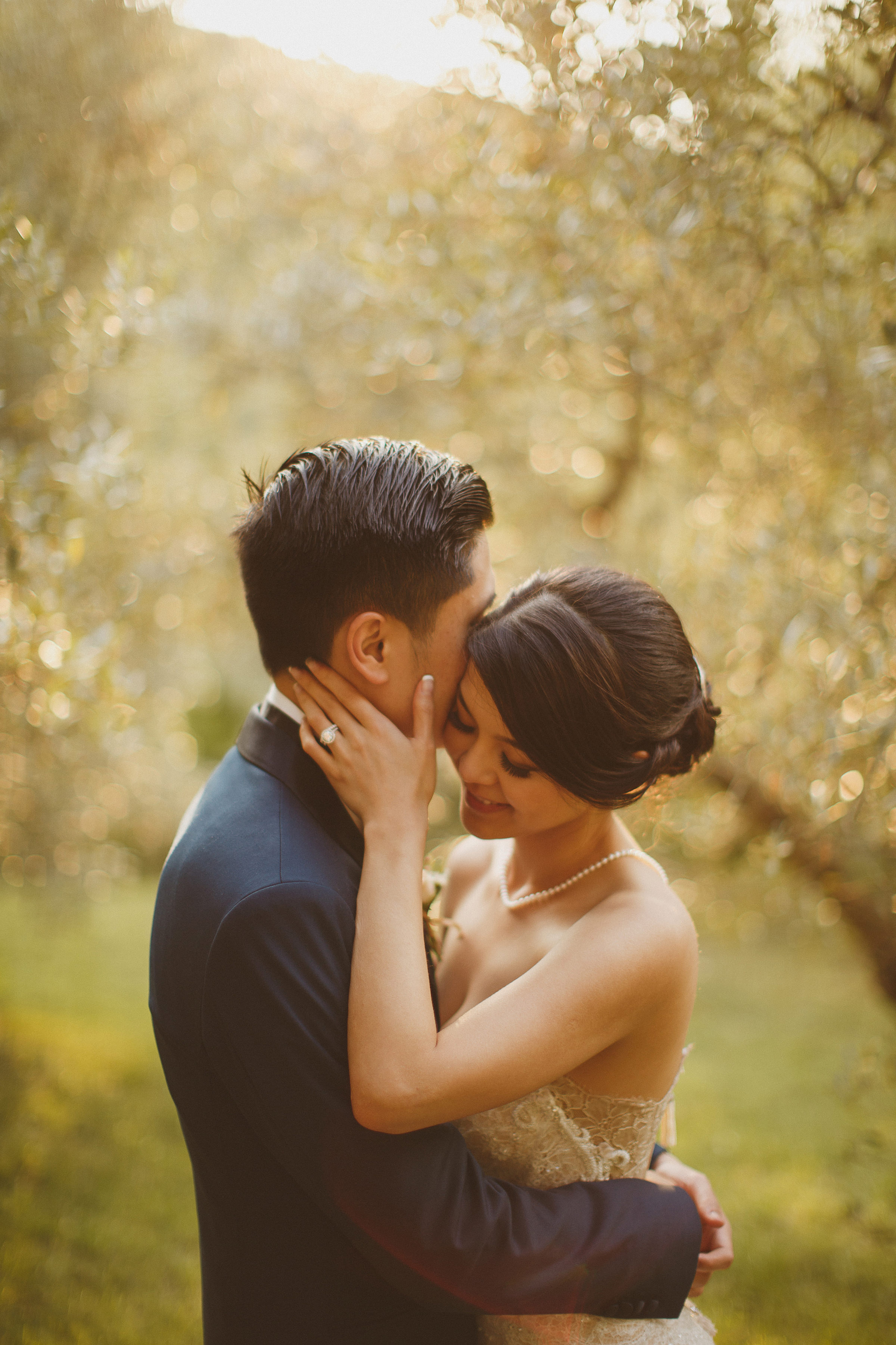 Sweet couple portrait against trees - photo by Ed Peers Photography