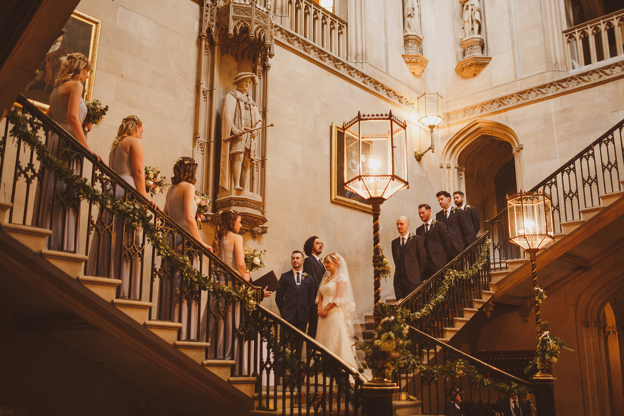 Ashridge House wedding ceremony on grand staircase - photo by Ed Peers Photography