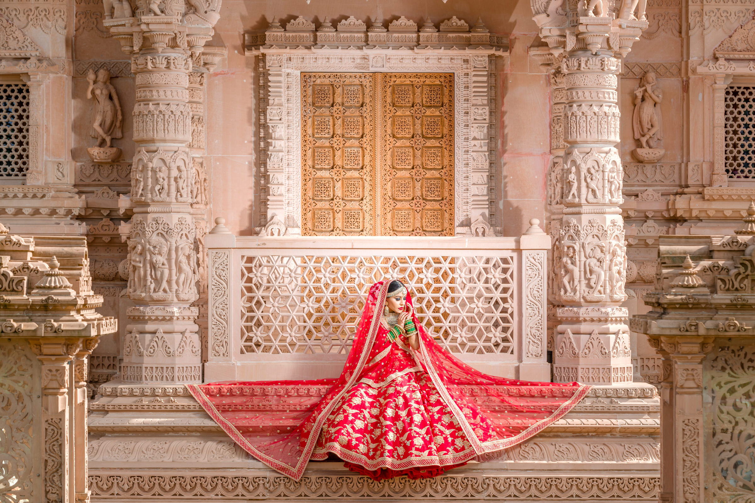 Indian bride in decorative architecture - photo by Eye Jogia Photography