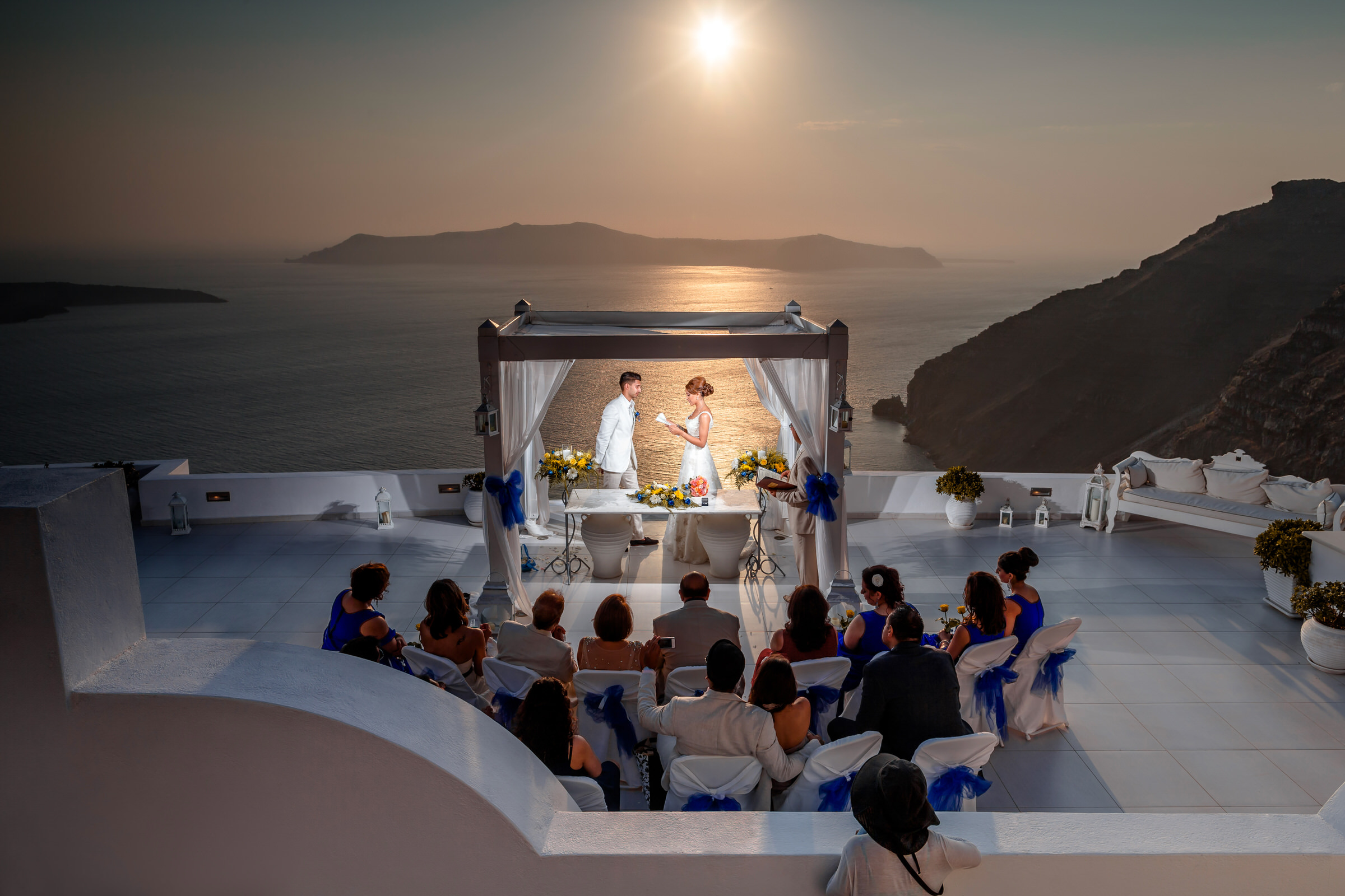Intimate evening outdoor ceremony under tent - photo by Eye Jogia Photography