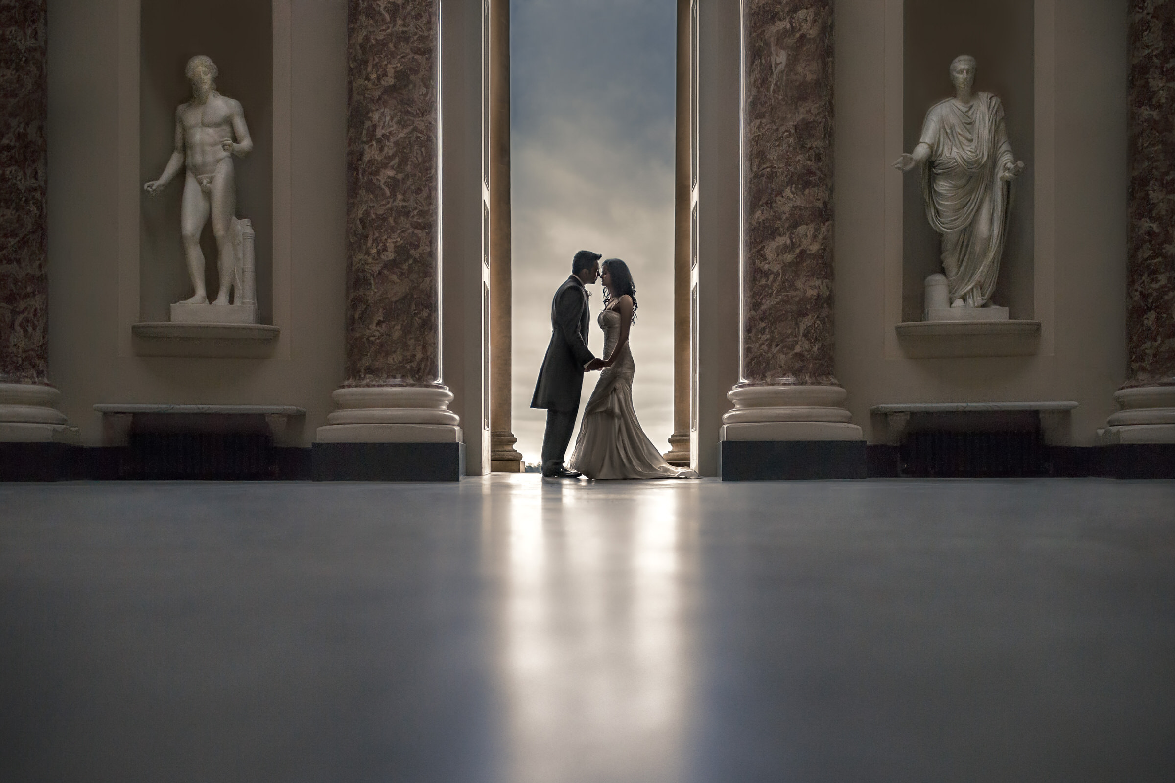 Luxury bride and groom portrait against columns and statuary - photo by Eye Jogia Photography