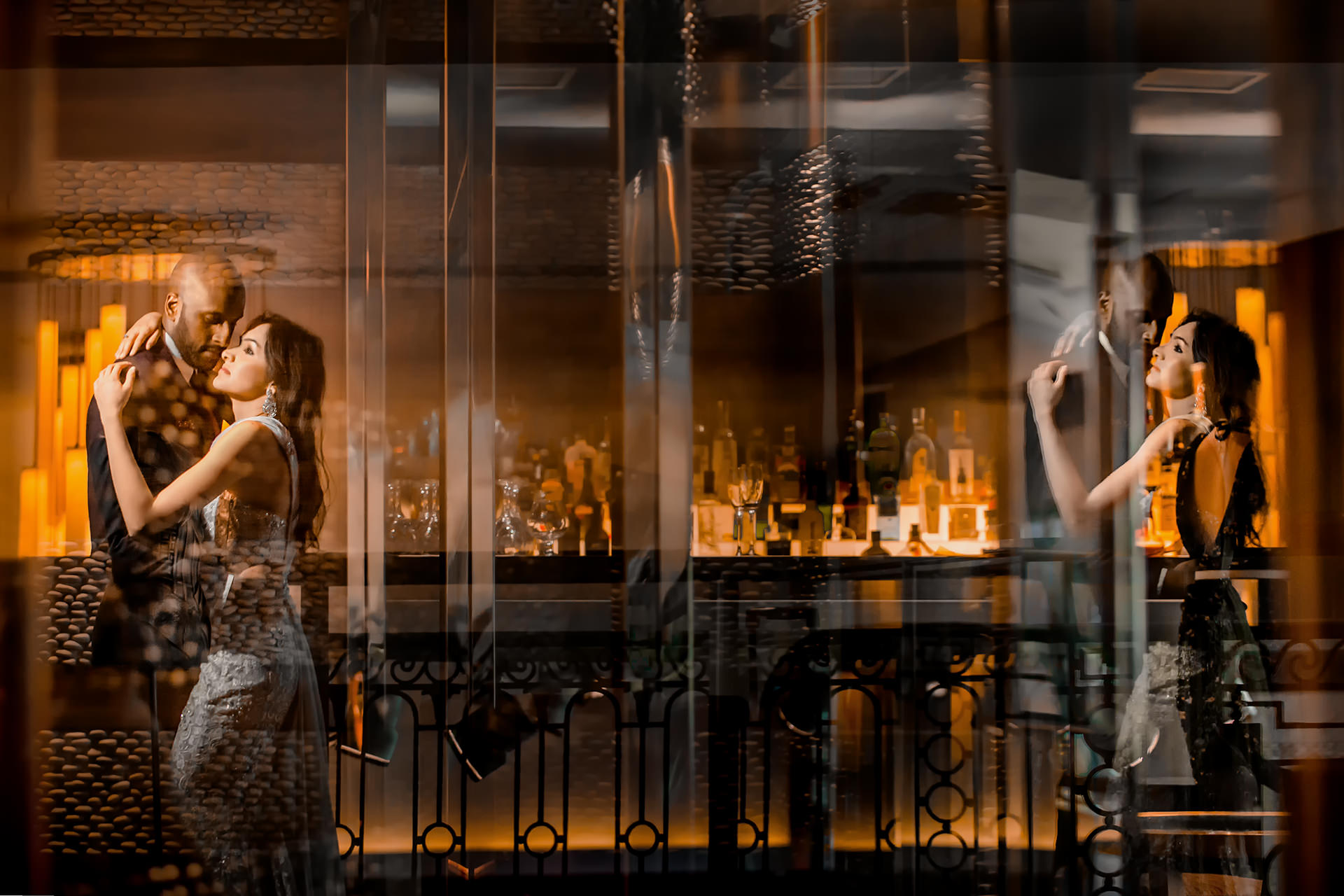 Multiple reflections of couple at bar - photo by Eye Jogia Photography