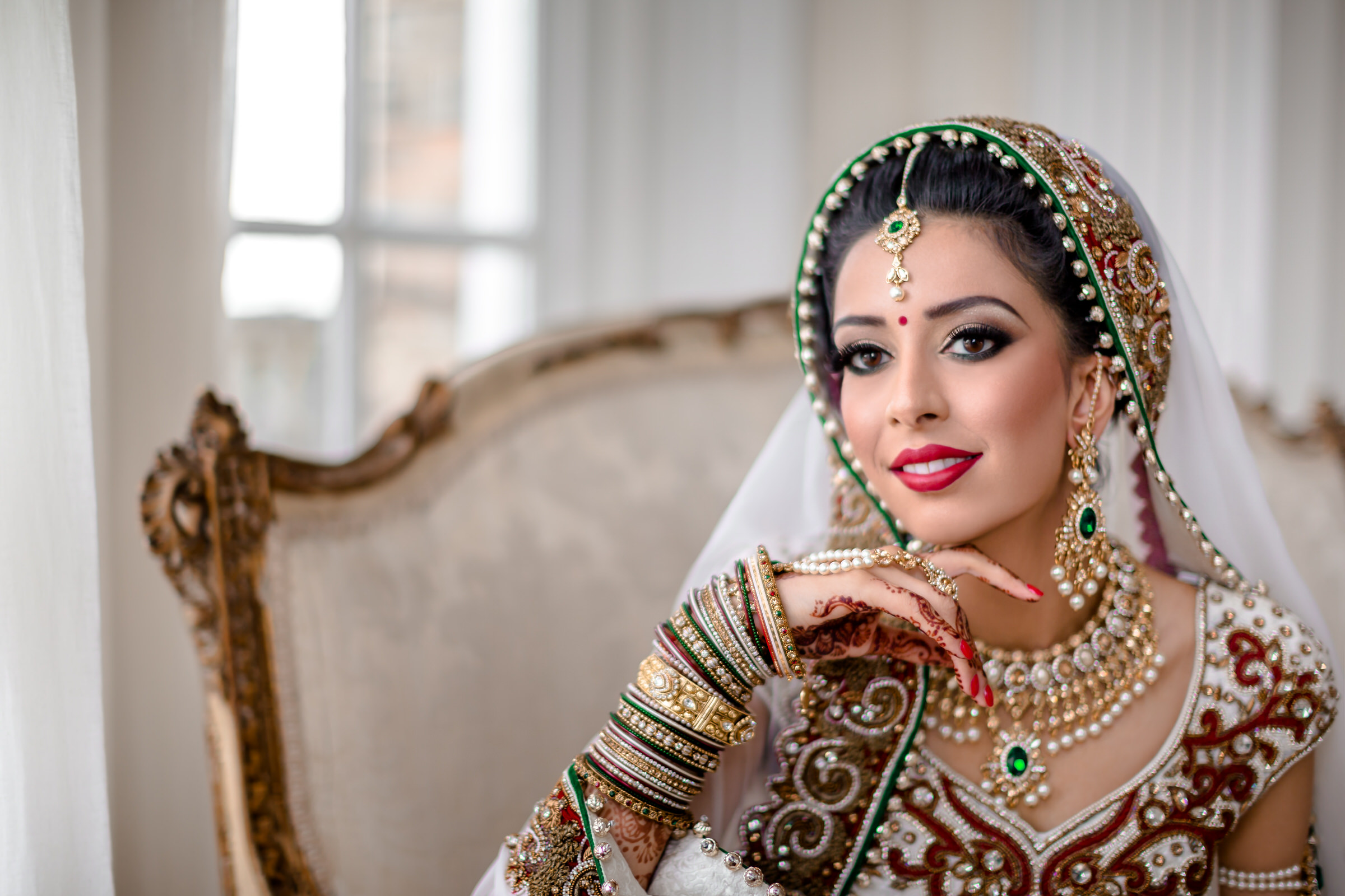Seated portrait of stunning Indian bride - photo by Eye Jogia Photography