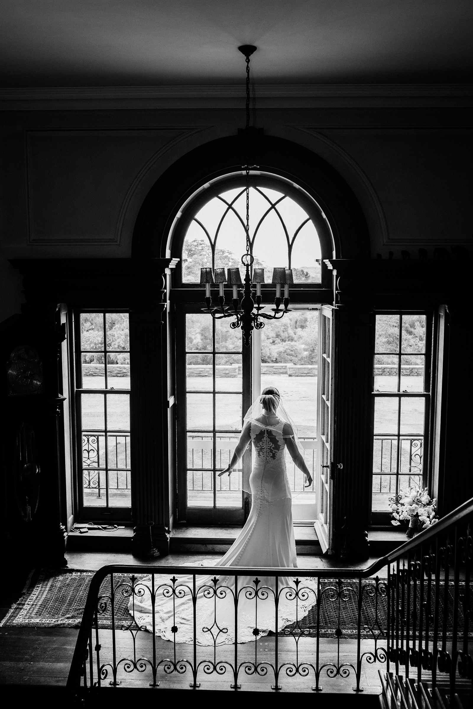 Bride looking out french doors- photo by Kelli Wilke Photography