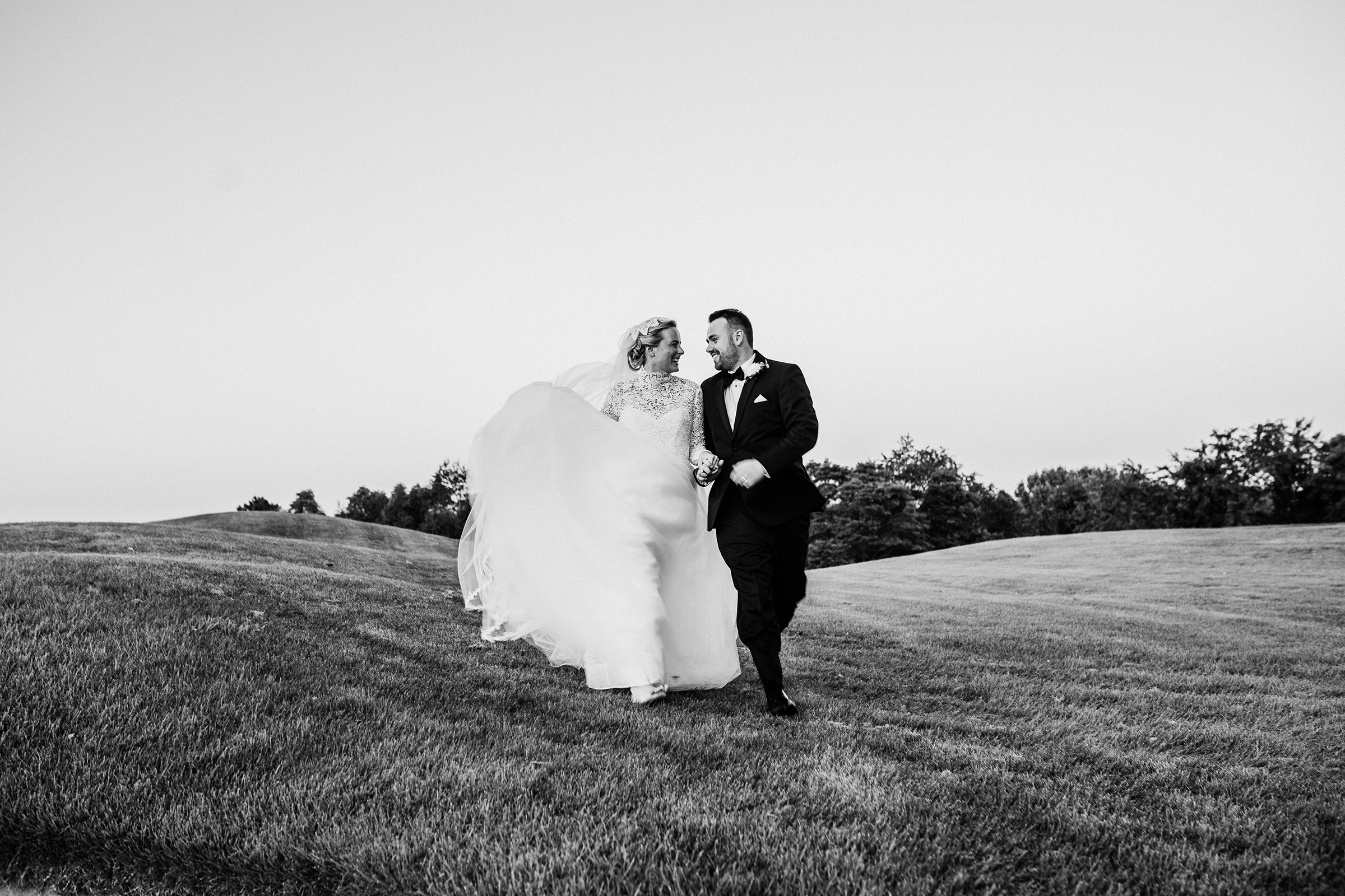 Couple portrait in field - photo by Kelli Wilke Photography