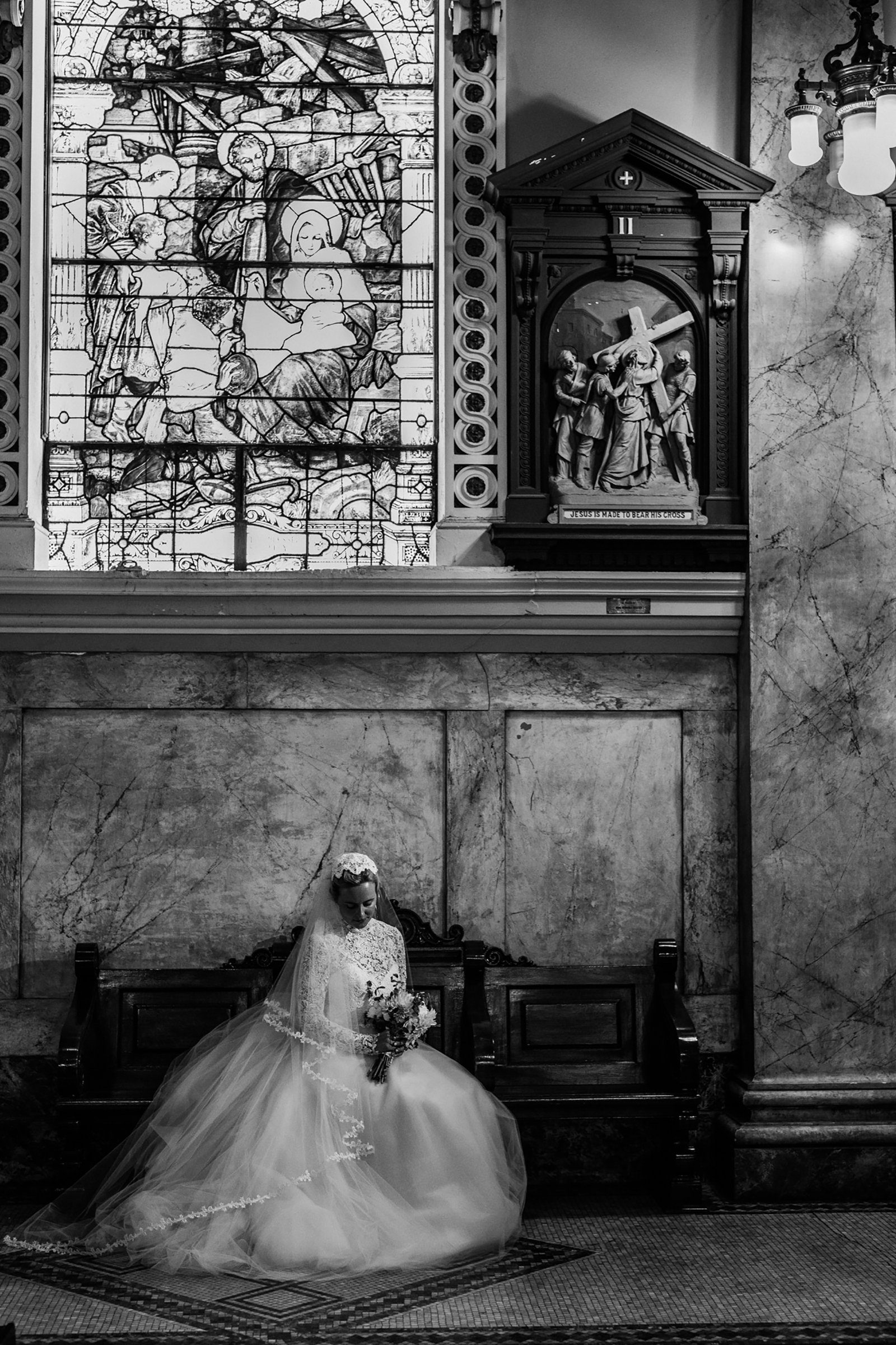 Seated bride portrait in church - photo by Kelli Wilke Photography