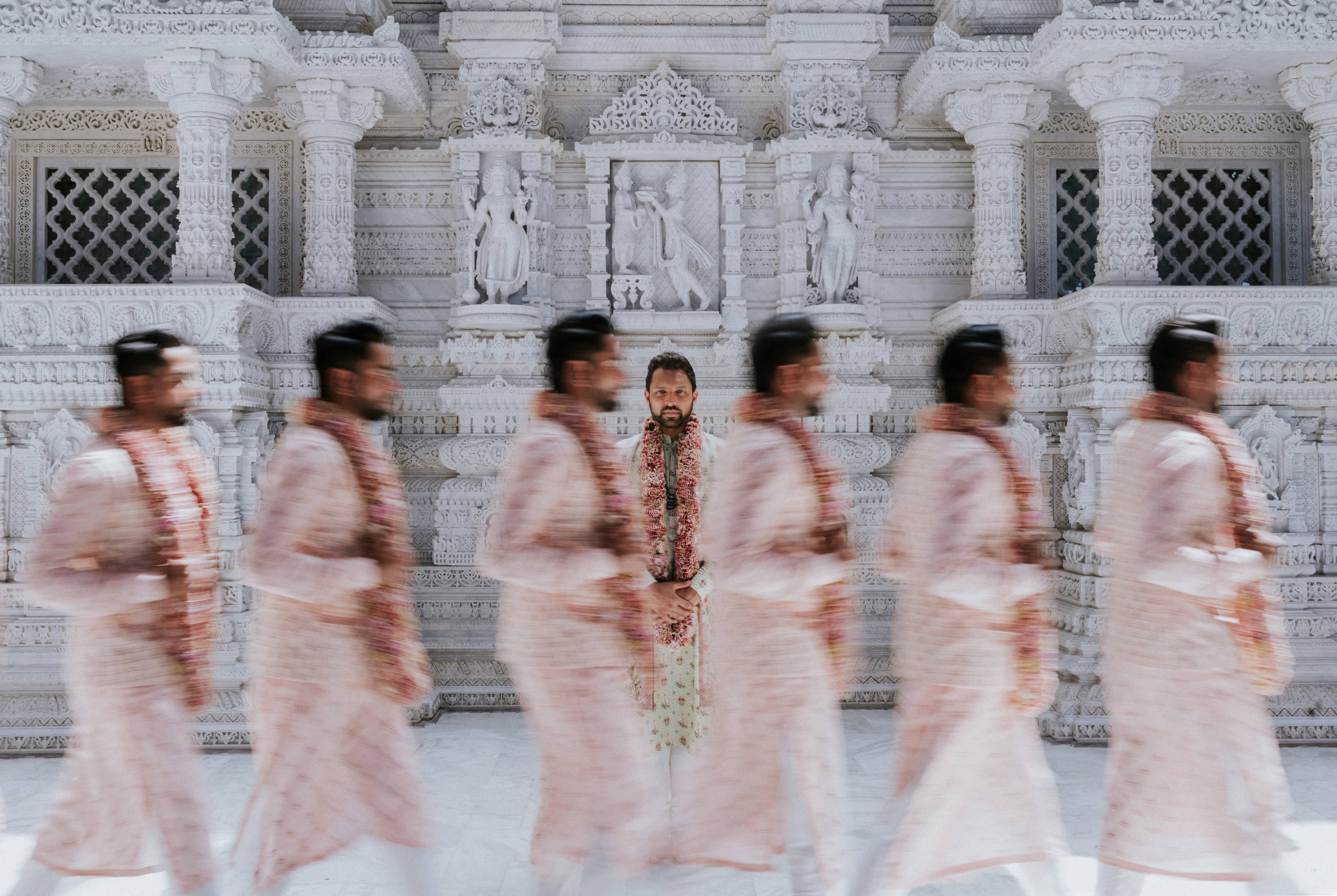 50 best wedding portraits of the decade- Long exposure group portrait of Indian groomsmen - photo by Charmi Pena