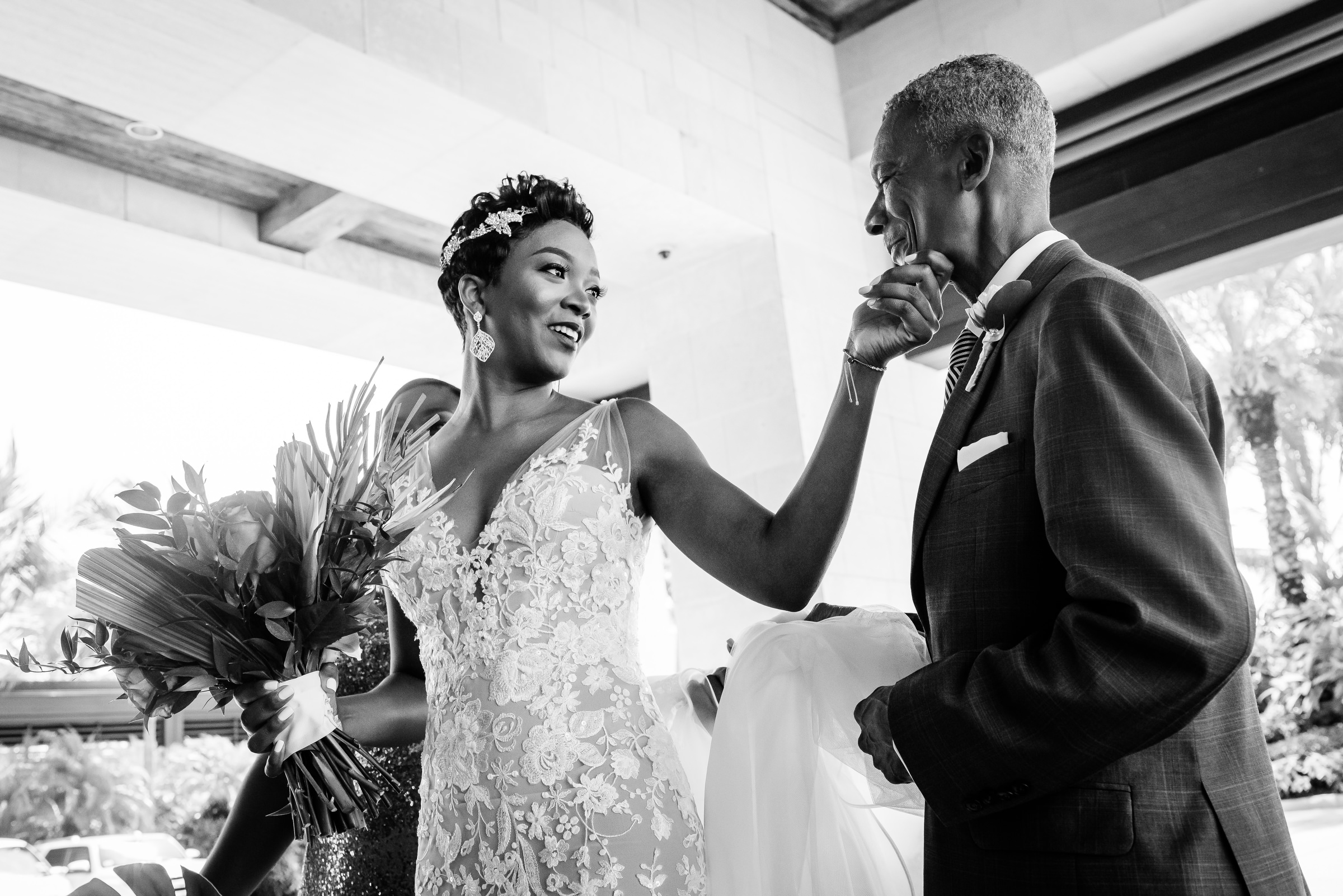 Affectionate gesture of bride to father nassau bahamas - photo by Kirth Bobb Photography