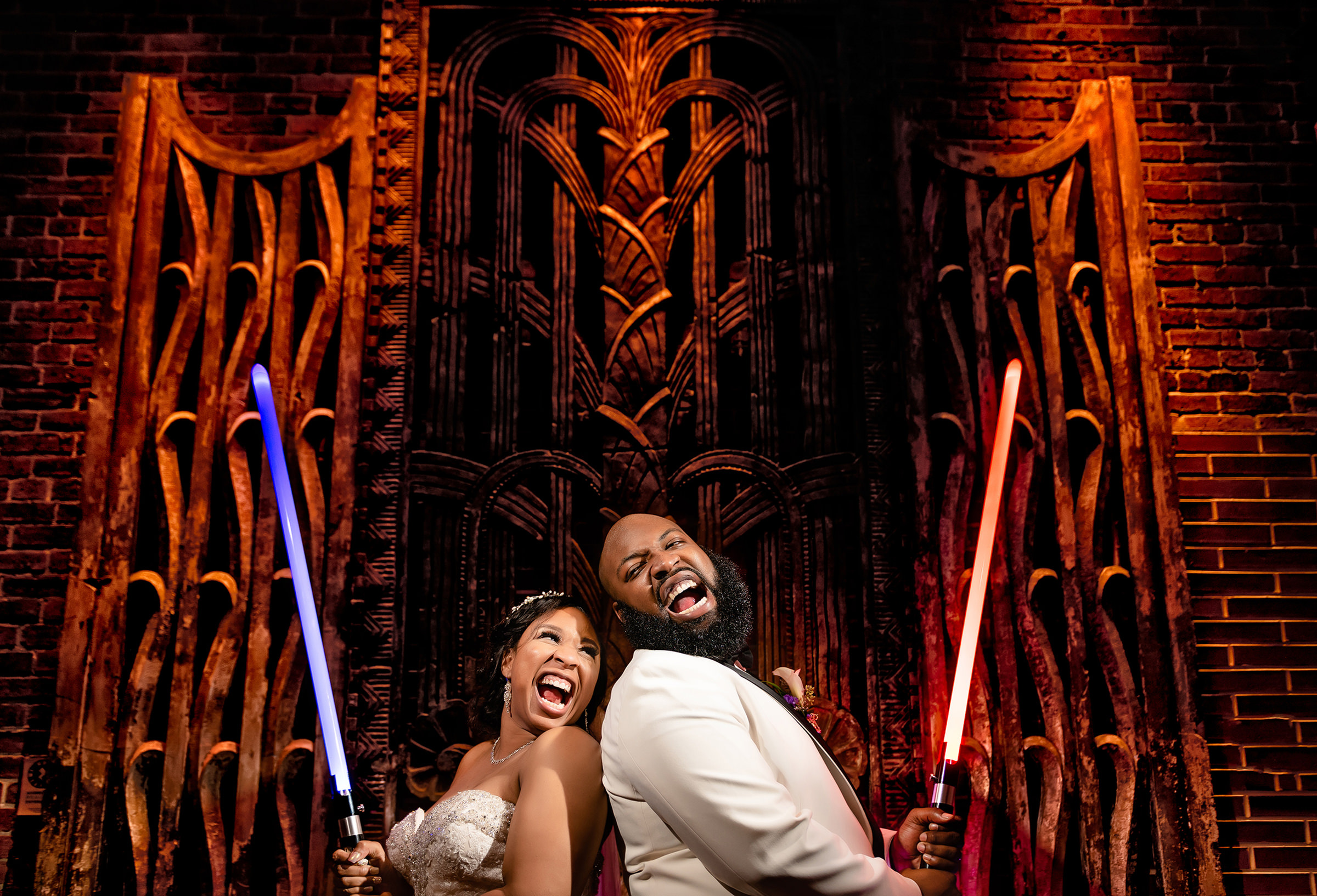 Bride and groom holding Star Wars lasers - photo by Kirth Bobb Photography