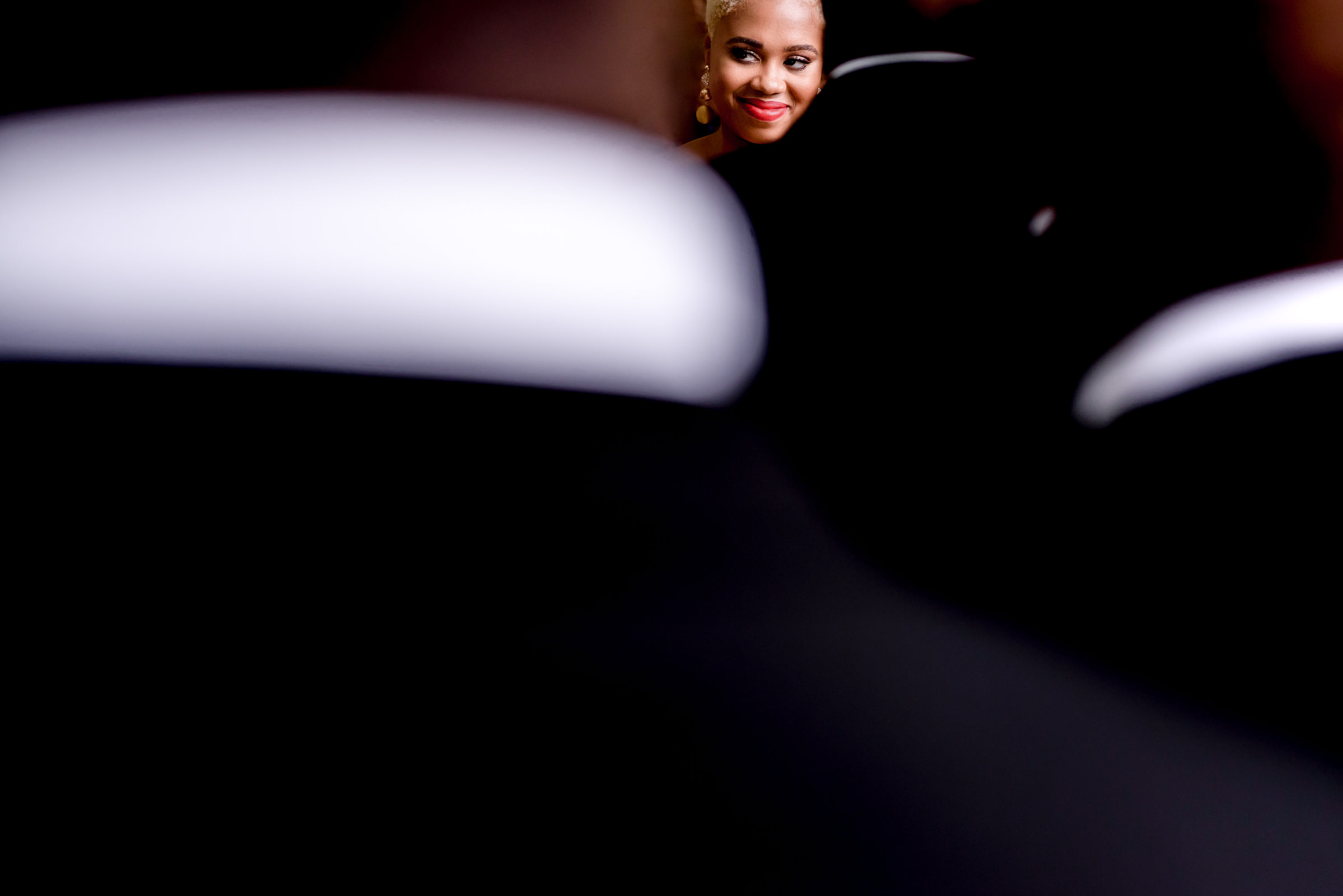 Bride with red lips through seen from grooms perspective - photo by Kirth Bobb Photography