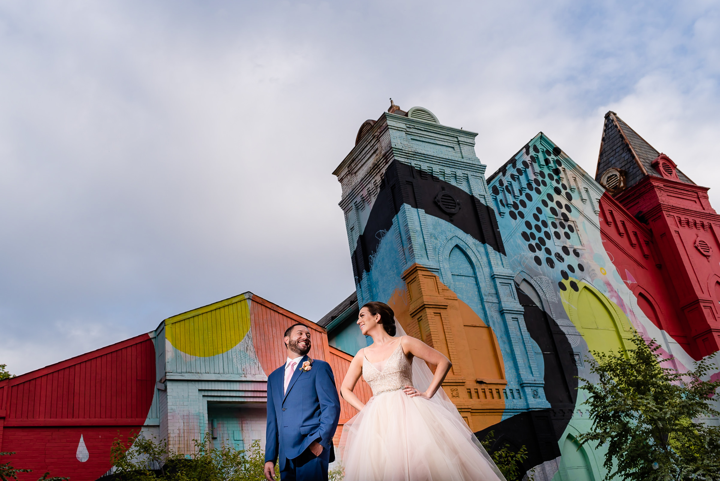 Couple against colorful culture house - photo by Kirth Bobb Photography