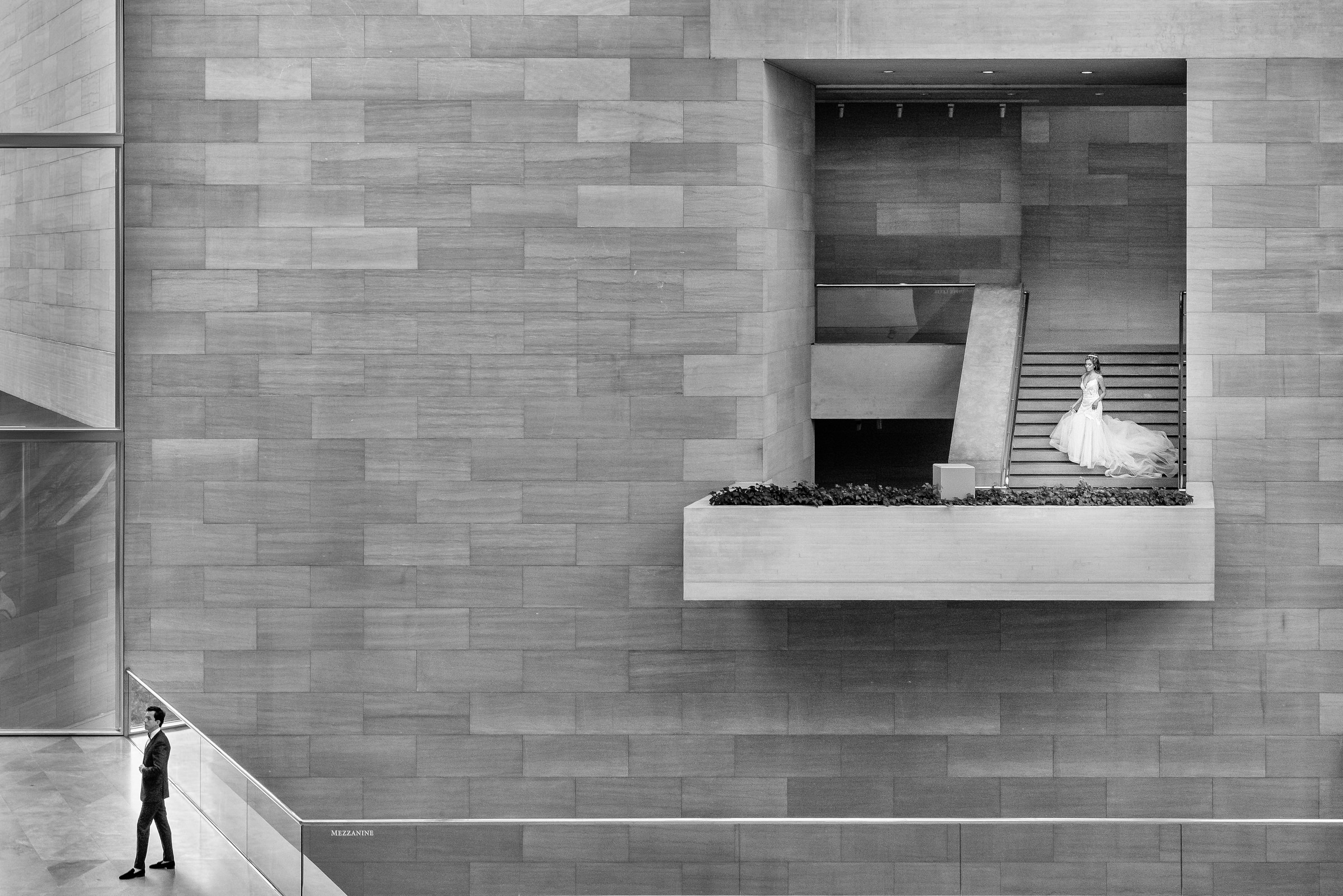 Groom and bride separately in modern architectural setting - photo by Kirth Bobb Photography