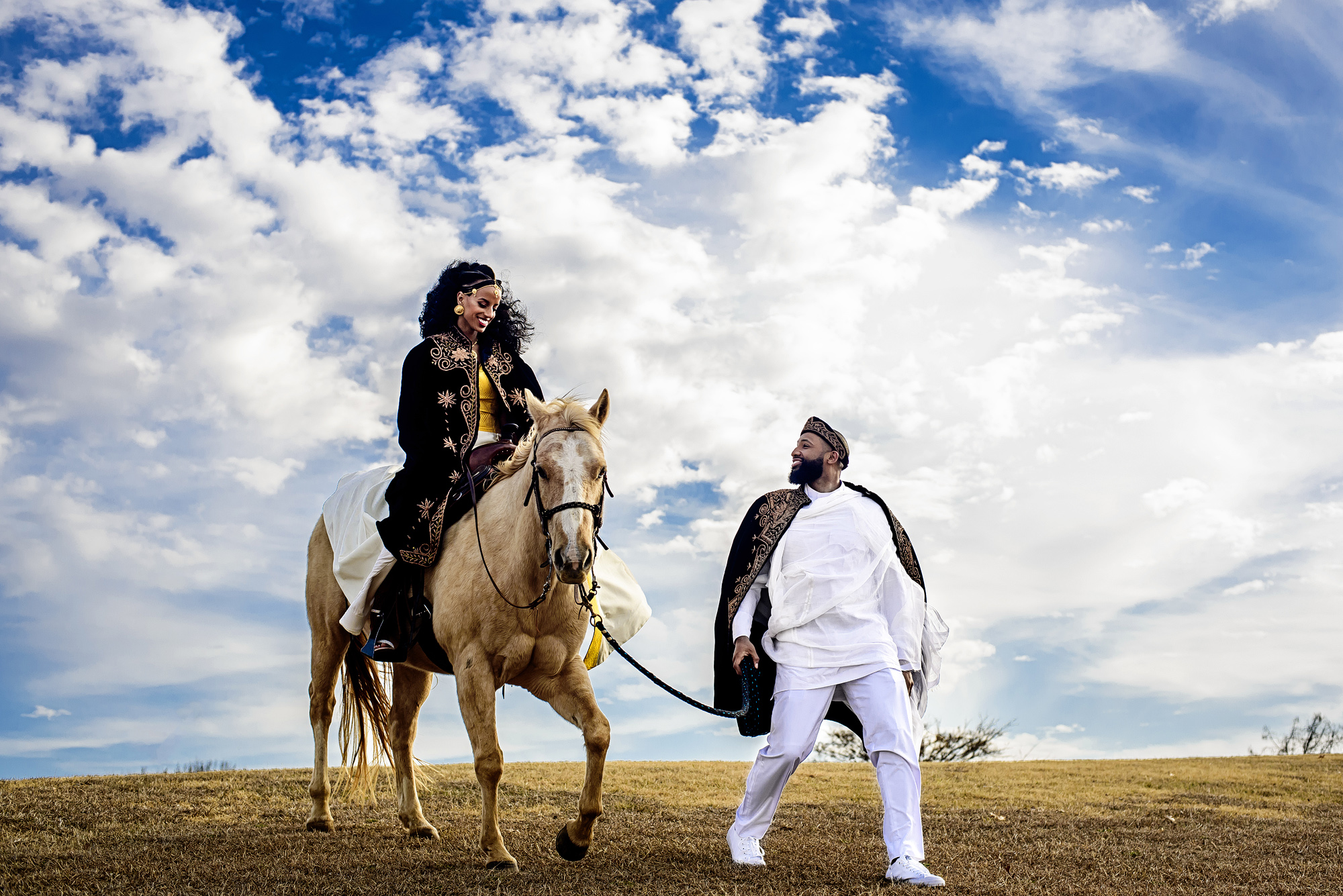 Bride on horseback with groom in muslim attire - photo by Joshua Dwain Photography