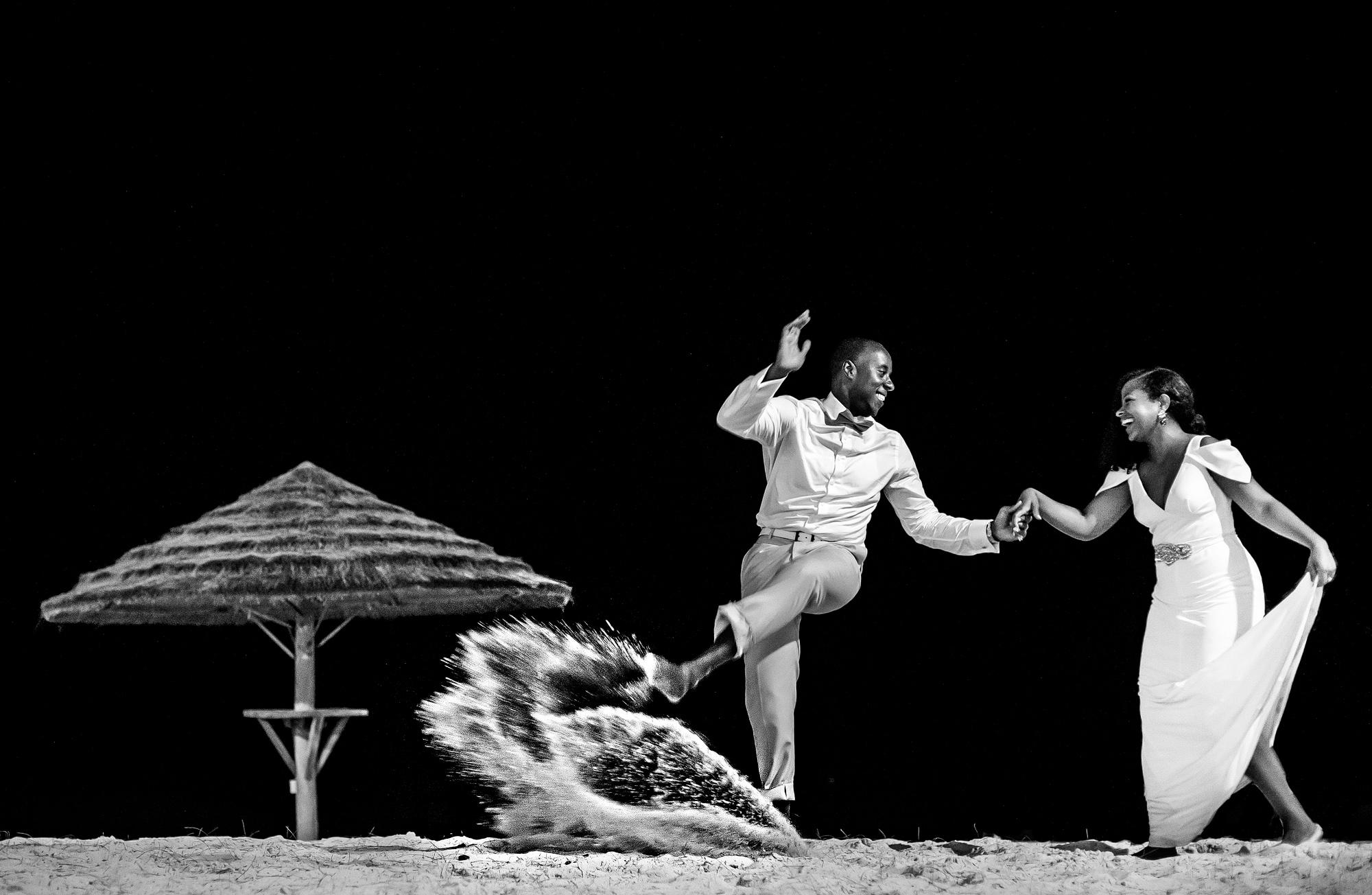 Couple dancing on beach - photo by Joshua Dwain Photography