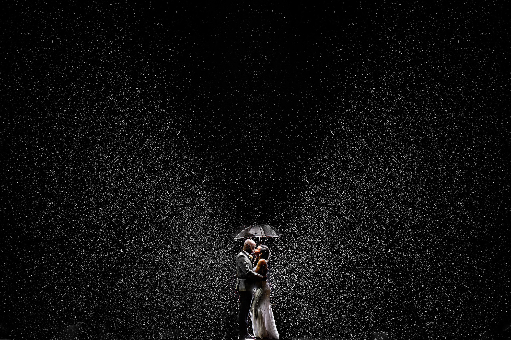 50 best wedding photo concepts - portrait under umbrella in the rain  by Joshua Dwain Photography