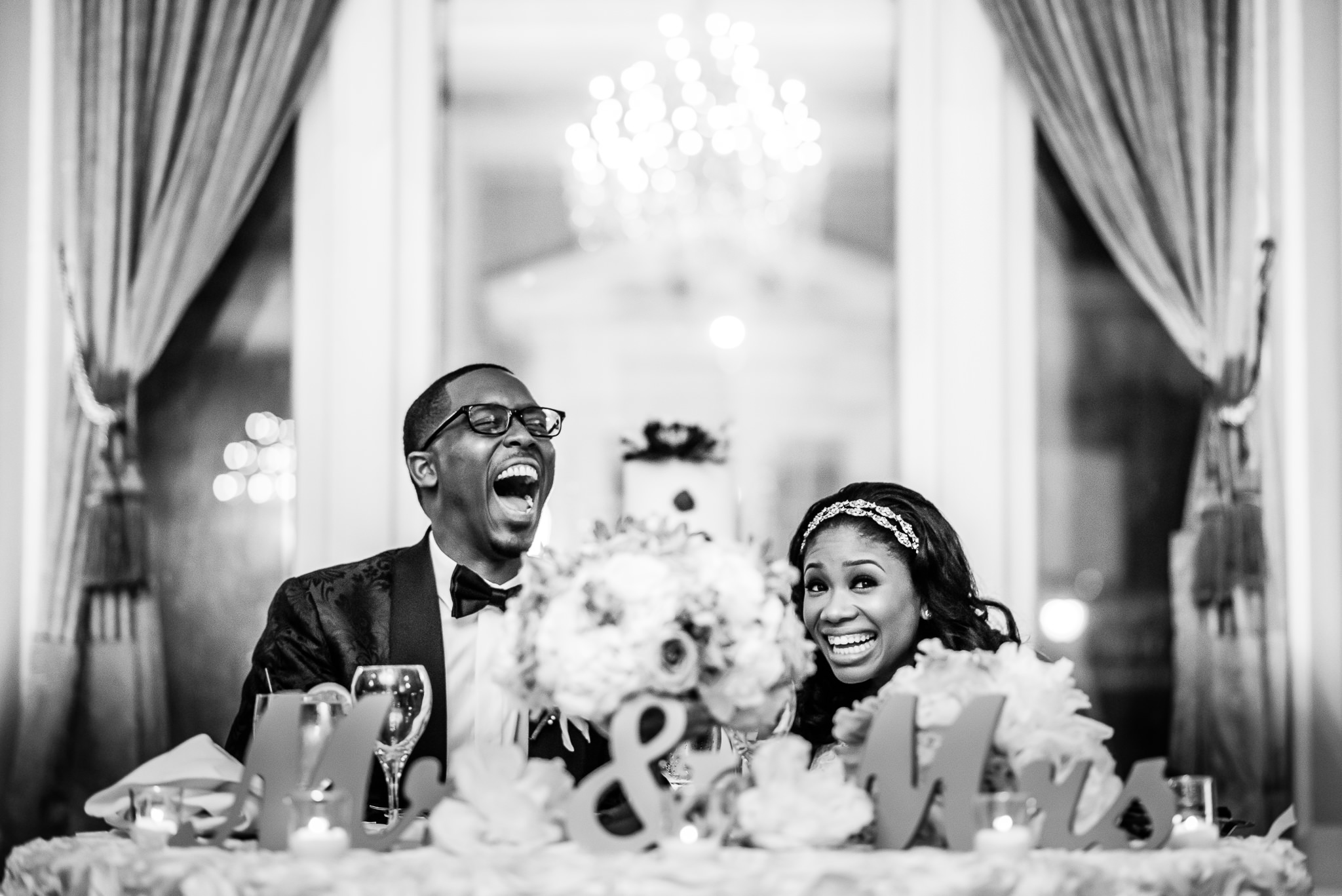Bride and groom laughing during reception - photo by Adibe Photography