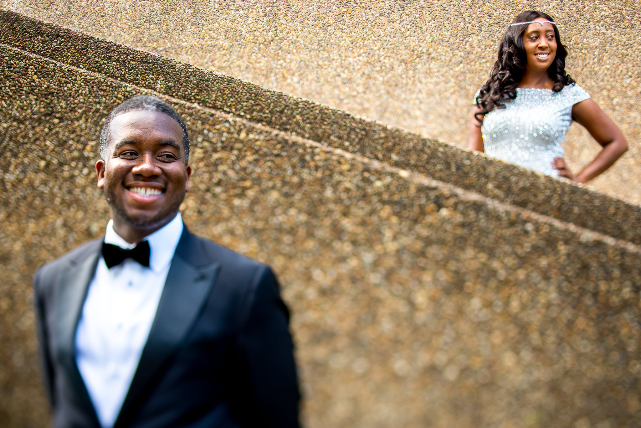 Bride and groom portrait against wall - photo by Adibe Photography