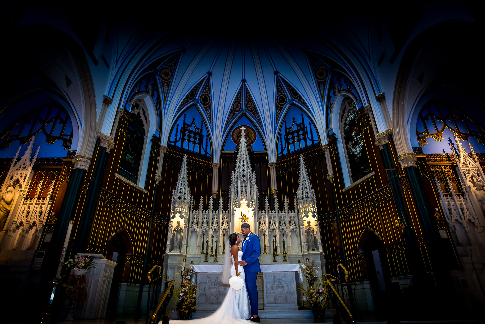 Bride and groom pose in cathedral- photo by Adibe Photography