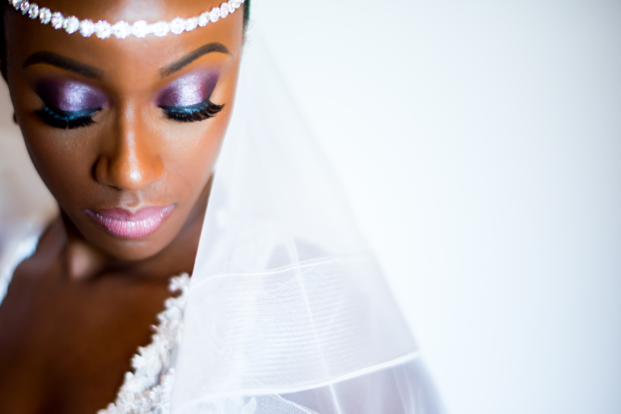 Portrait of bride with colorful eye makeup - photo by Adibe Photography