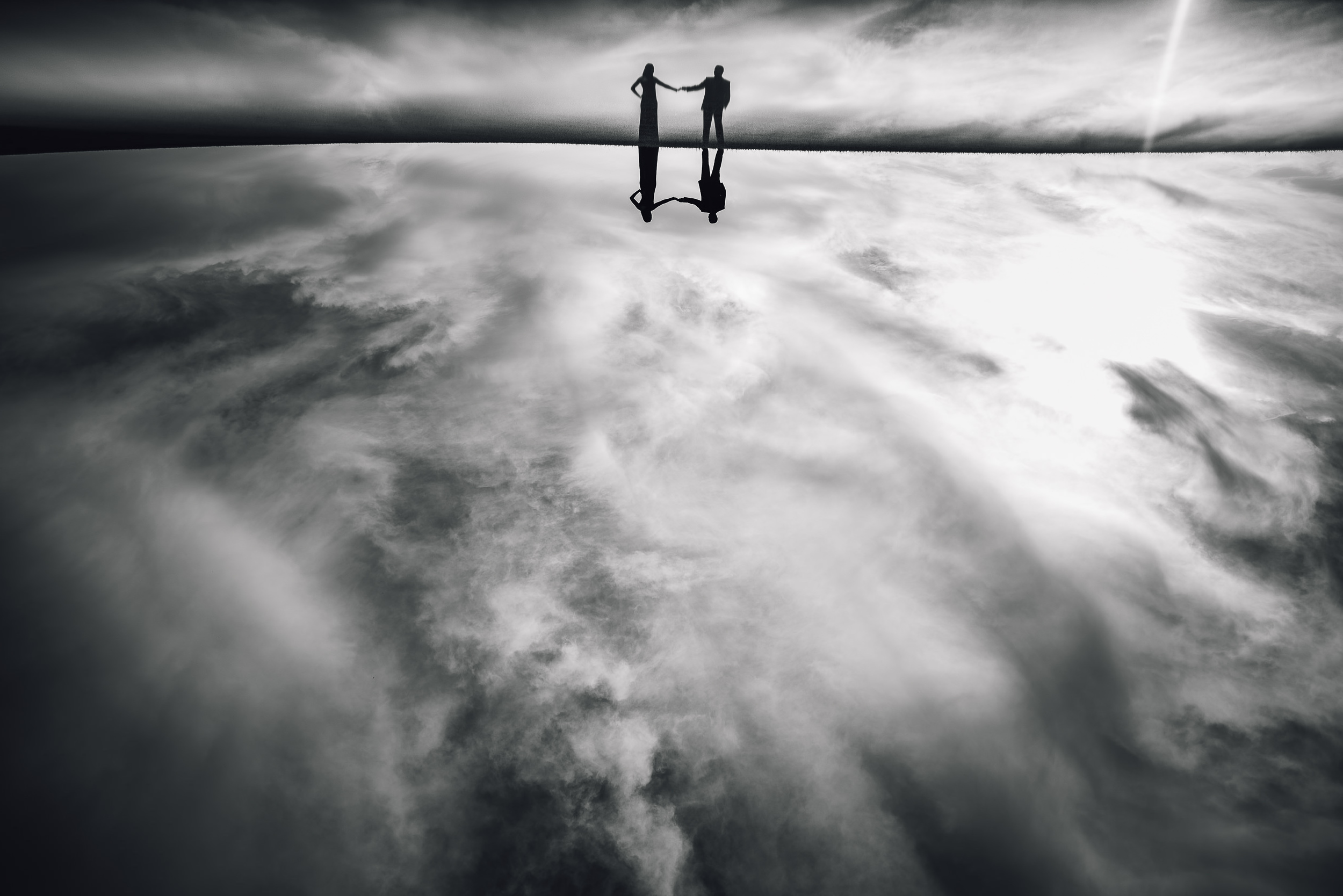 Walking on air silhouette of bride and groom by Adibe Photography